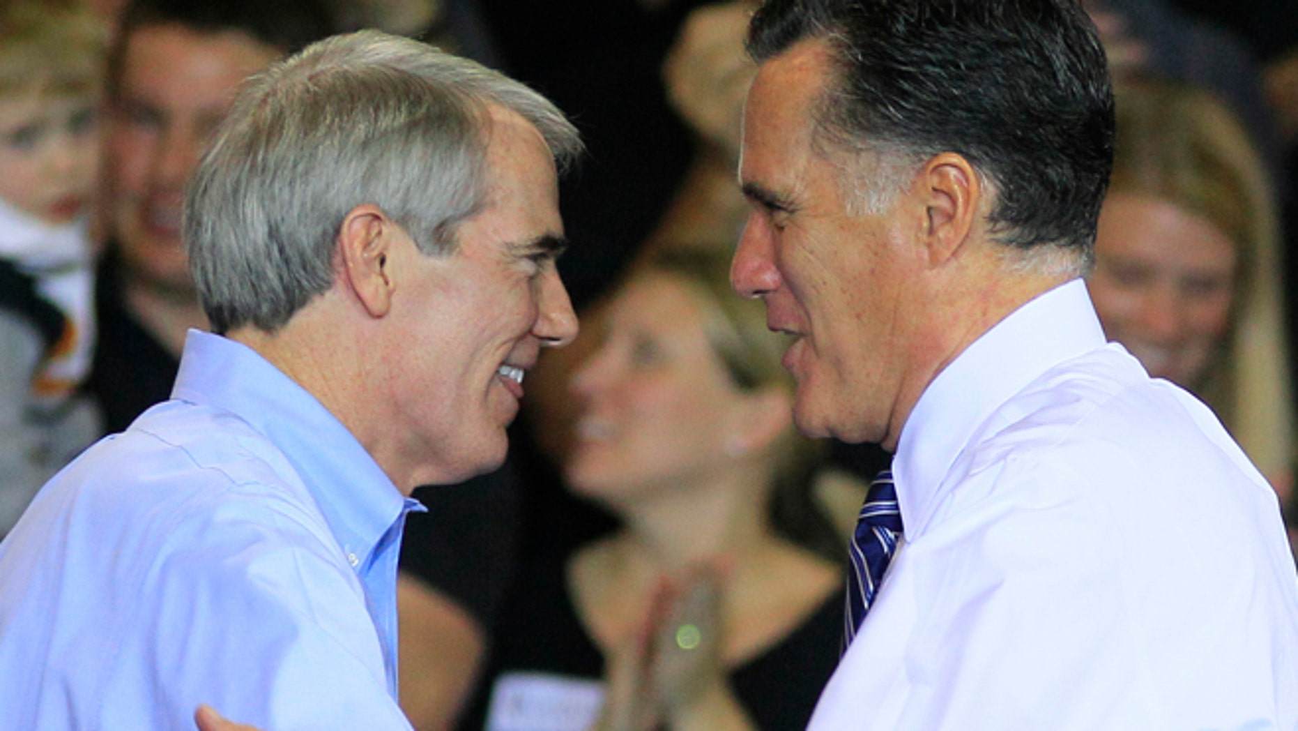 Oct. 25, 2012: In this file photo, Sen. Rob Portman, R-Ohio, left, shakes hands with Republican presidential candidate, former Massachusetts Gov. Mitt Romney after Portman introduced Romney at a campaign stop at defense contractor Jet Machine in Cincinnati.