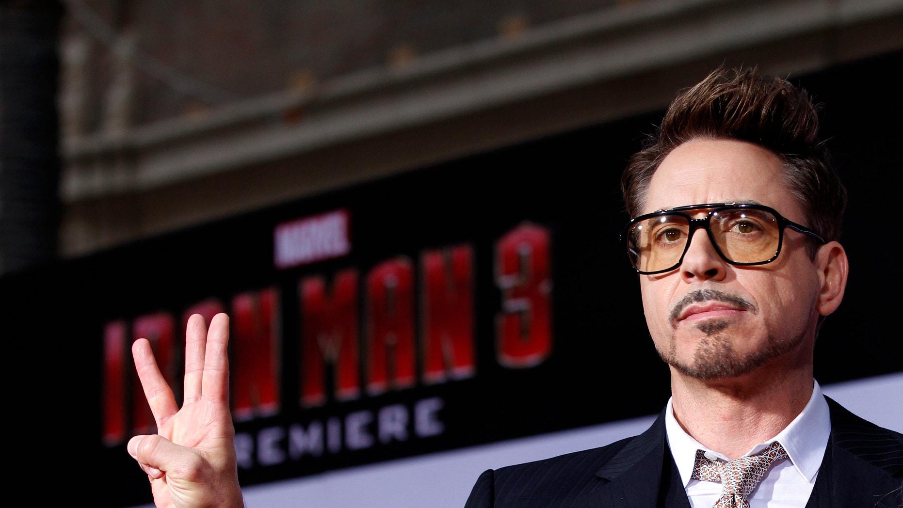 "Cast member Robert Downey Jr. poses at the premiere of ""Iron Man 3"" at El Capitan theatre in Hollywood, California April 24, 2013."