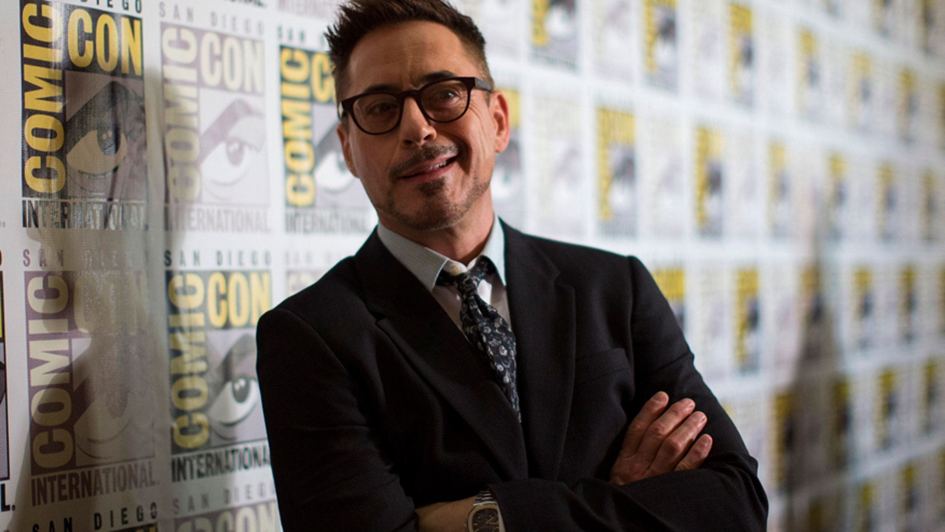 """Cast member Robert Downey Jr. poses at a press line for """"Avengers: Age of Ultron"""" during the 2014 Comic-Con International Convention in San Diego, California July 26, 2014."""