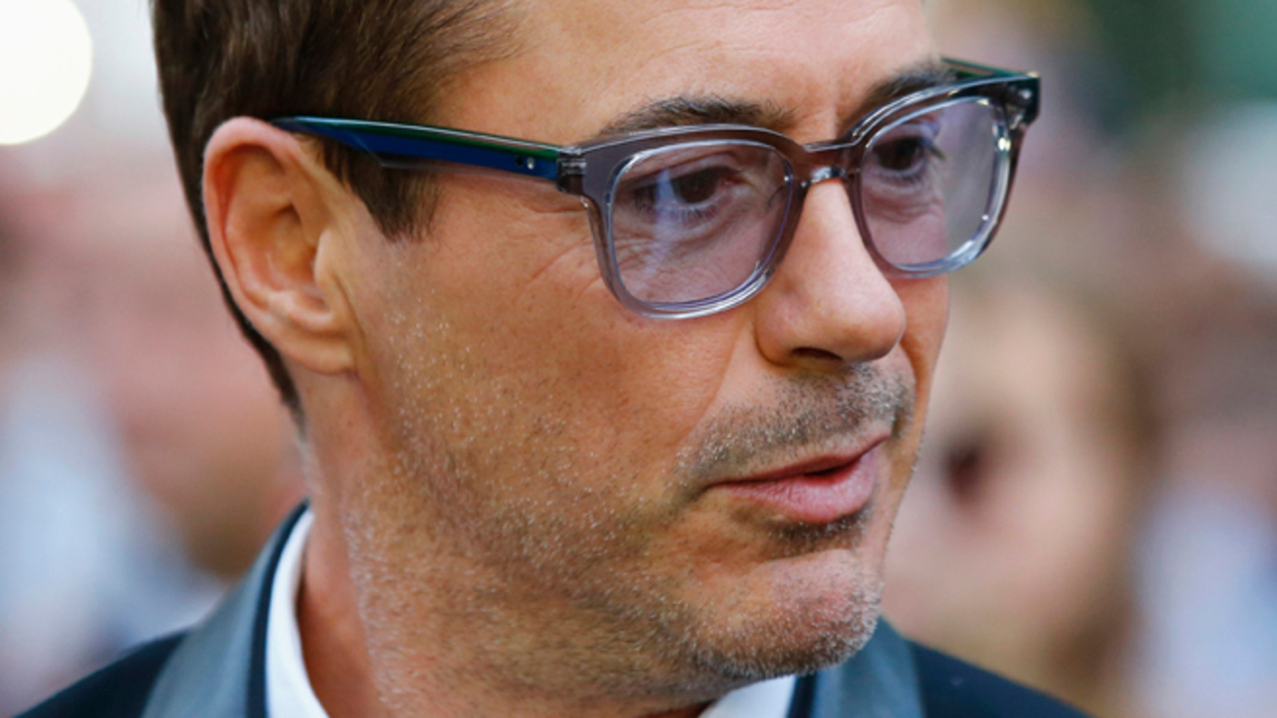 "Actor Robert Downey Jr. arrives for the gala for the film ""The Judge"" at the Toronto International Film Festival (TIFF) September 4, 2014.    REUTERS/Mark Blinch (CANADA - Tags: ENTERTAINMENT) - RTR45081"