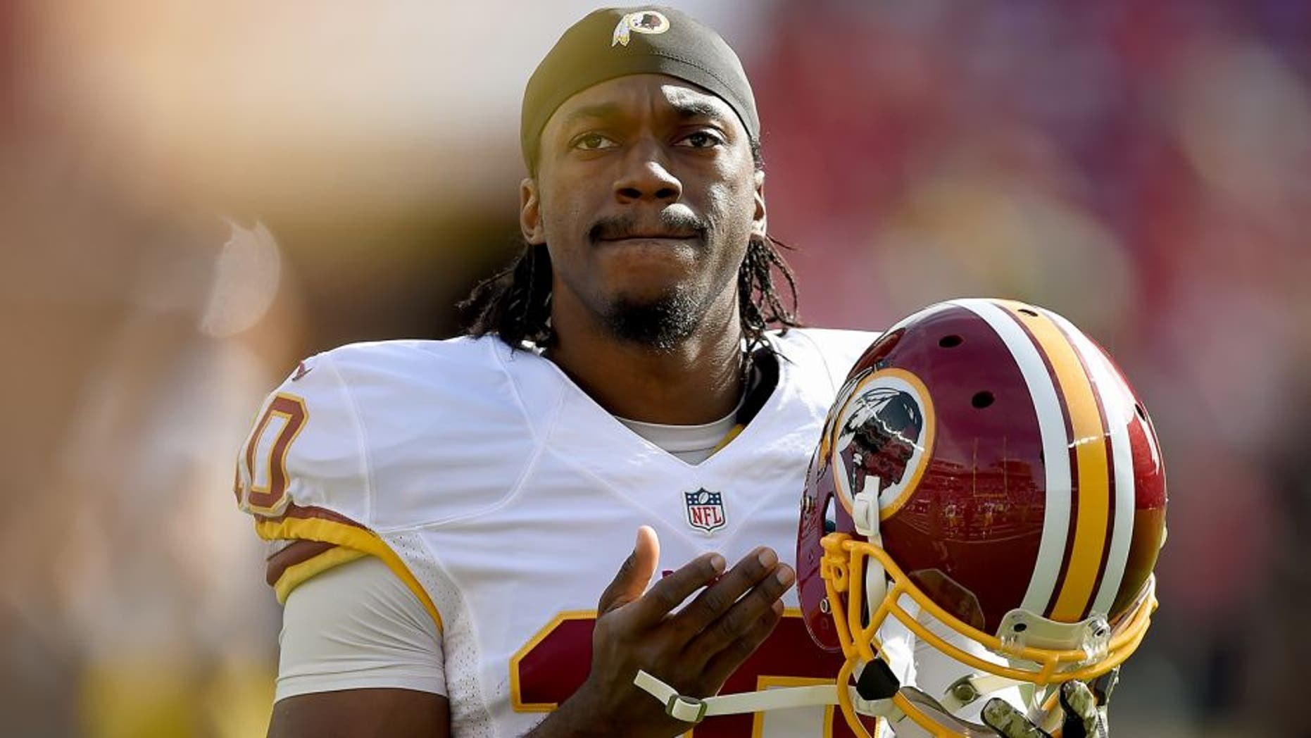SANTA CLARA, CA - NOVEMBER 23: Robert Griffin III #10 of the Washington Redskins looks on during pre-game warm ups prior to playing the San Francisco 49ers at Levi's Stadium on November 23, 2014 in Santa Clara, California. (Photo by Thearon W. Henderson/Getty Images)
