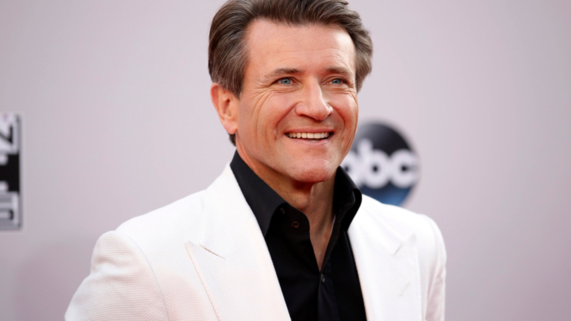 "Robert Herjavec, from the reality show ""Shark Tank,"" arrives at the 42nd American Music Awards in Los Angeles, California November 23, 2014."