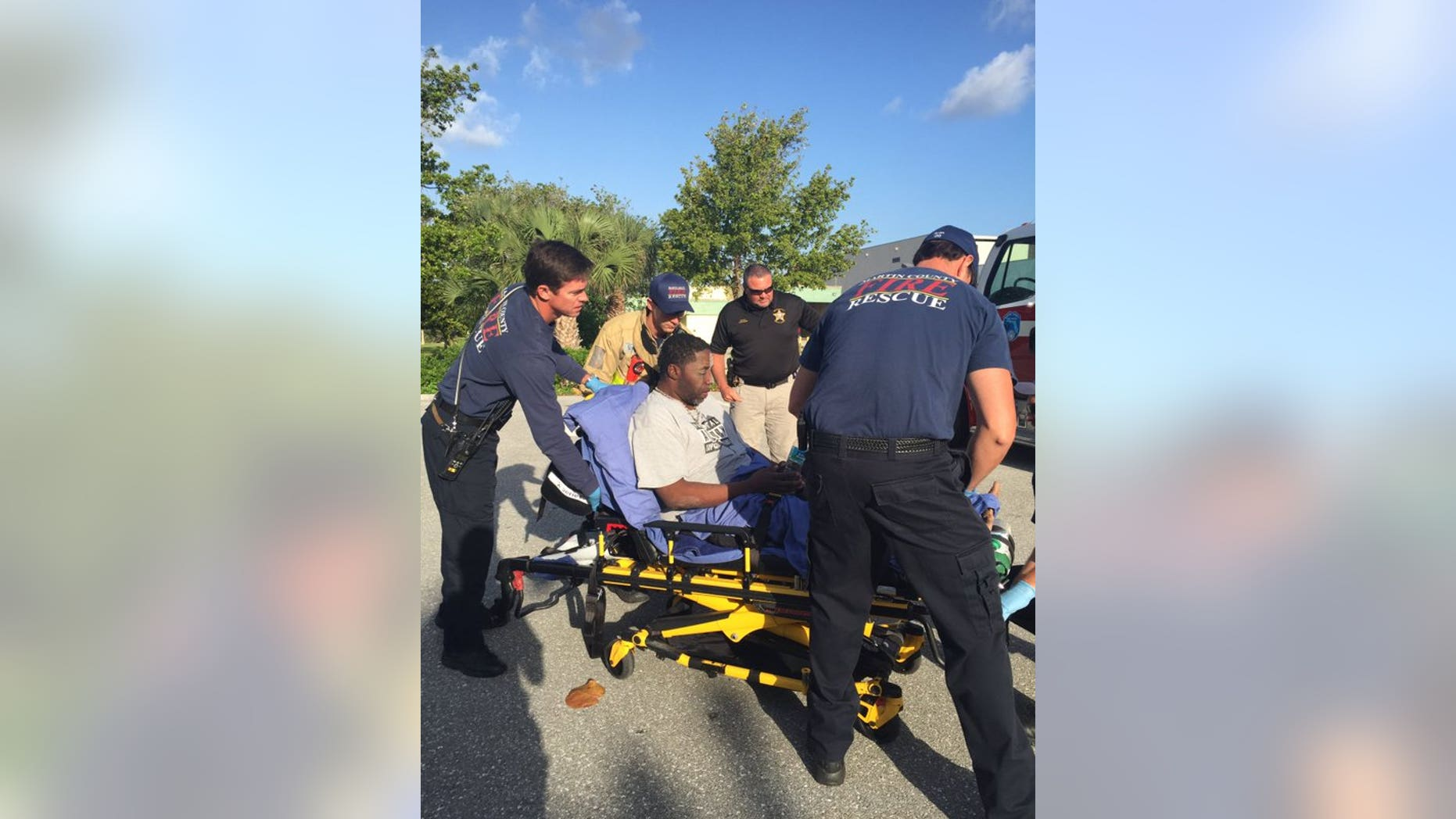 Paramedics tending to Robert Stewart.