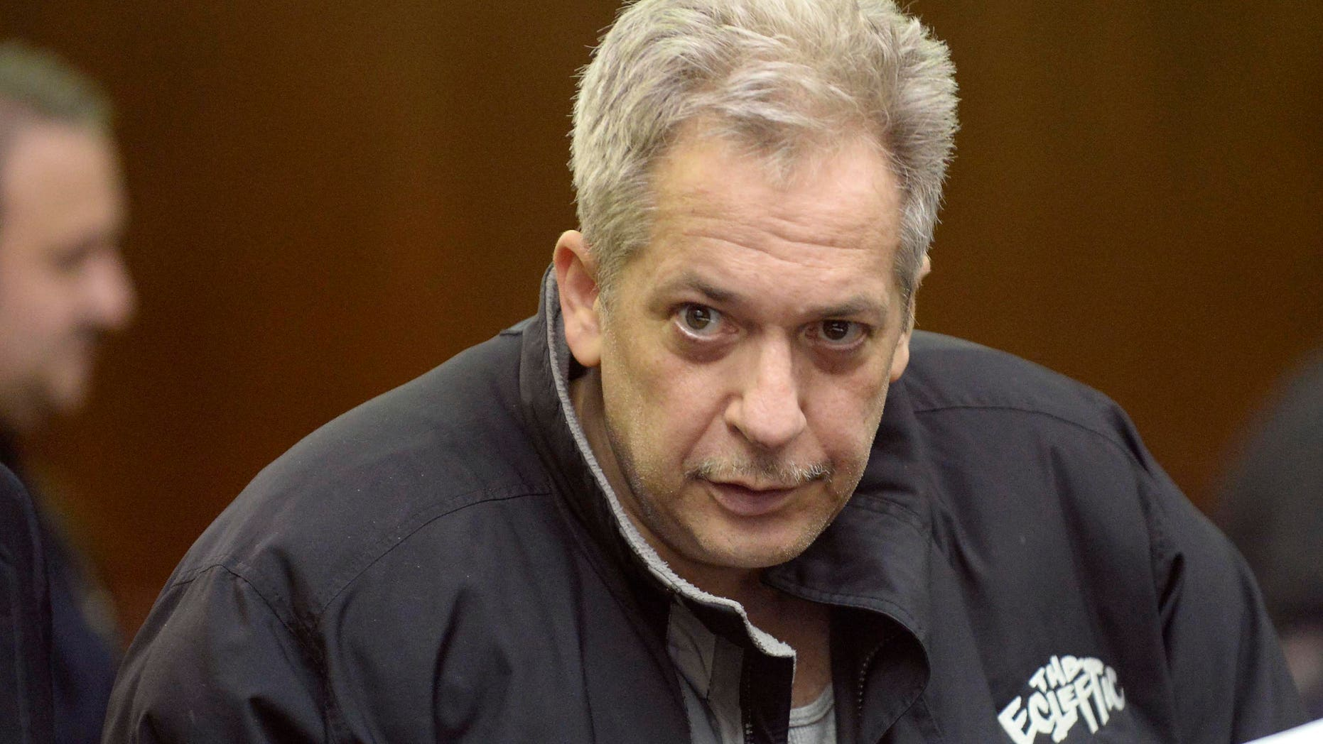 February 5, 2014. Robert Vineberg stares at a camera during his arraignment in court in New York. Three men and one woman arrested in New York have been charged with drugs offences possibly connected to narcotics found at the home of film star Philip Seymour Hoffman following his death of an apparent heroin overdose, law enforcement officials said.