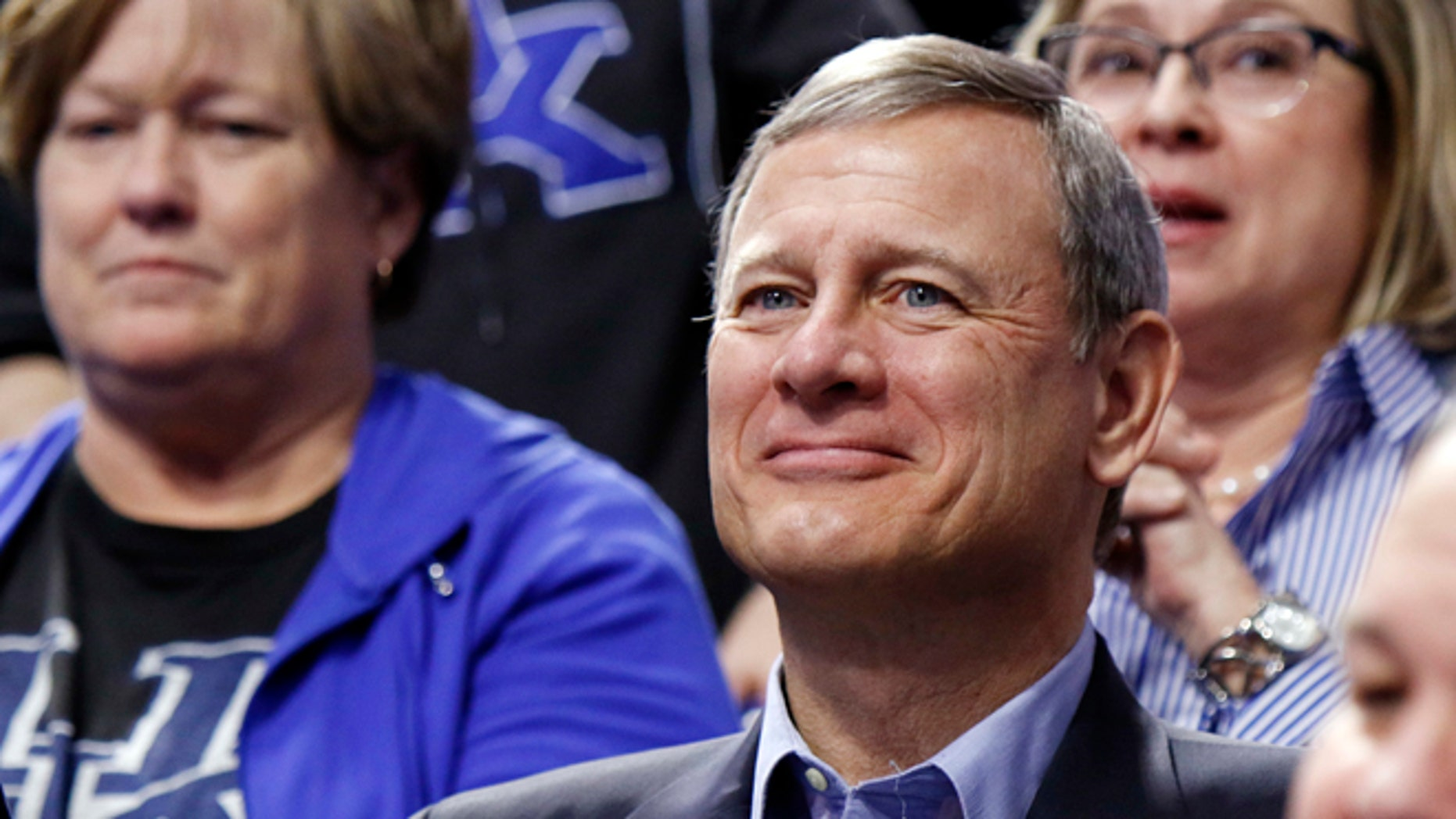 Chief Justice of the U.S. Supreme Court John Roberts watches the first half of an NCAA college basketball game between Kentucky and Georgia, Tuesday, Jan. 31, 2017, in Lexington, Ky. (AP Photo/James Crisp)
