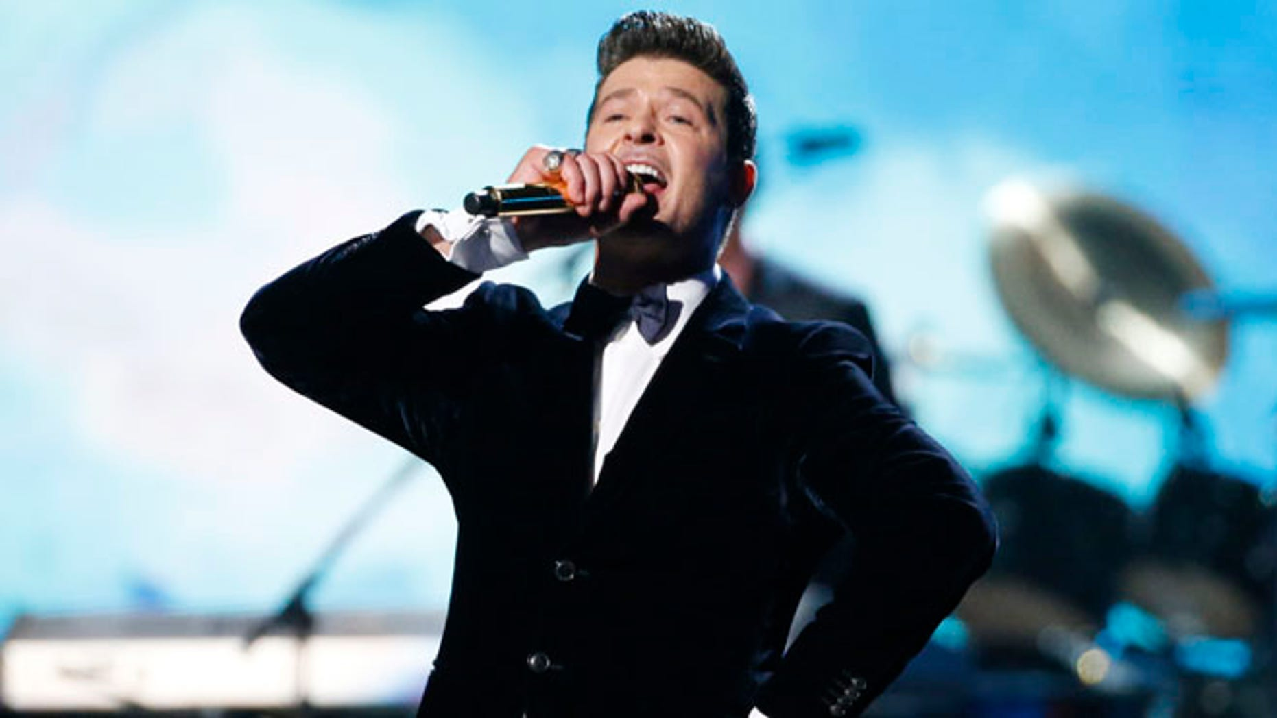 "Jan. 26, 2014: Robin Thicke performs ""Blurred Lines"" with Chicago at the 56th annual Grammy Awards in Los Angeles, California."