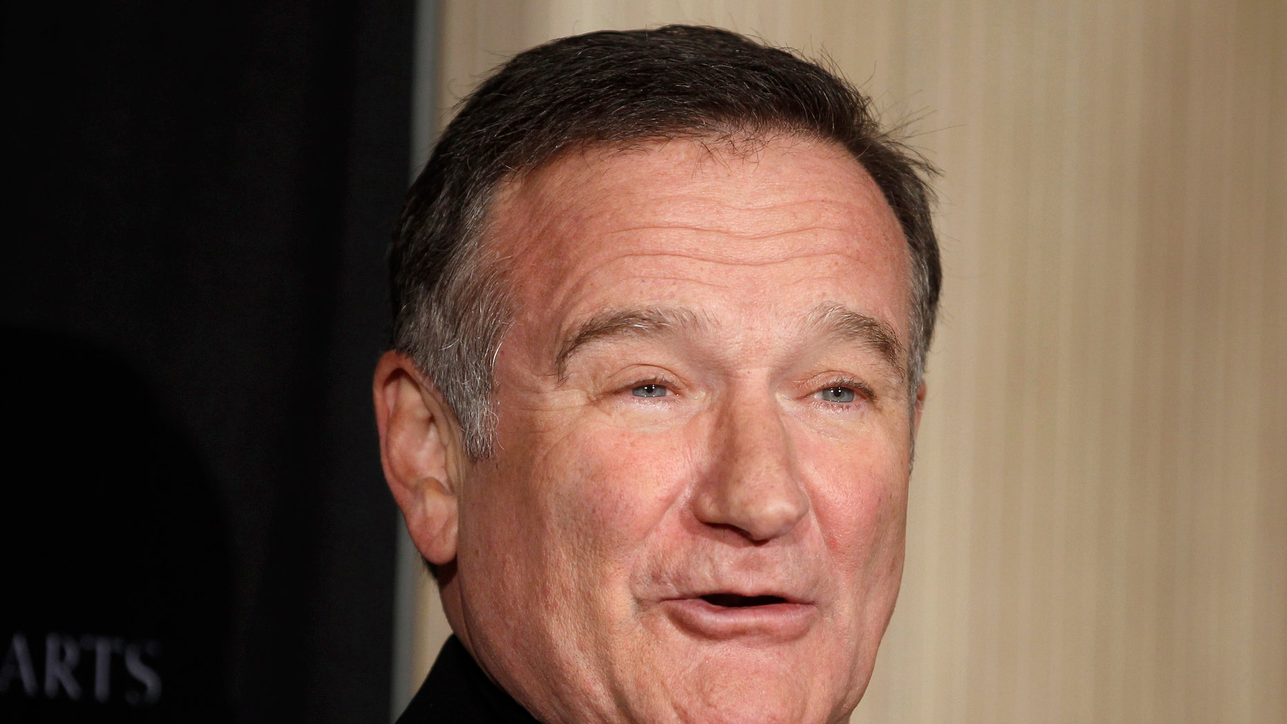 Actor Robin Williams poses as he arrives at the British Academy of Film and Television Arts Los Angeles Britannia Awards in Beverly Hills, California November 30, 2011.