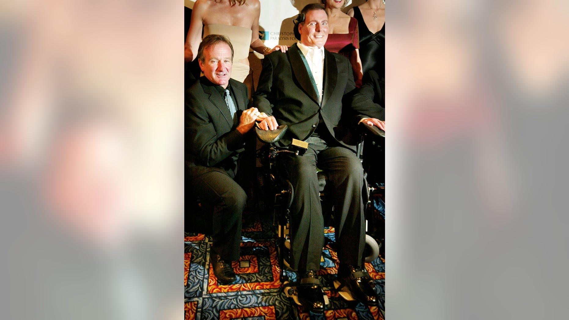 September 25, 2002. Actors Christopher Reeve (R) and Robin Williams pose for photographers as they arrive at party to celebrate Reeve's 50th birthday in New York City.