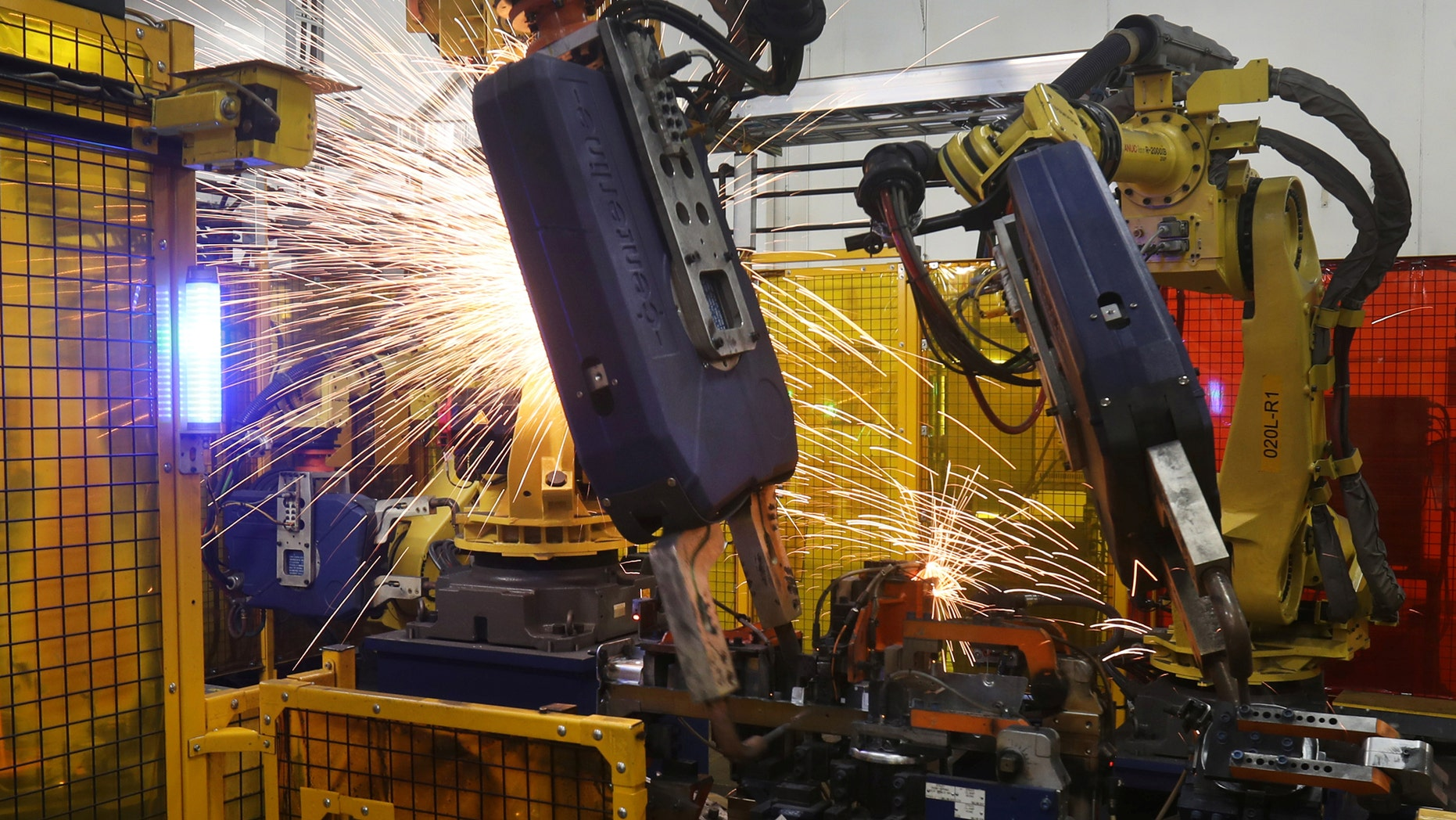 File photo: Robot welders on the floor of Alfield Industries, a subsidiary of Martinrea, one of three global auto parts makers in Canada, in Vaughan, Ontario, Canada April 28, 2017. Picture taken April 28, 2017. (REUTERS/Fred Thornhill)