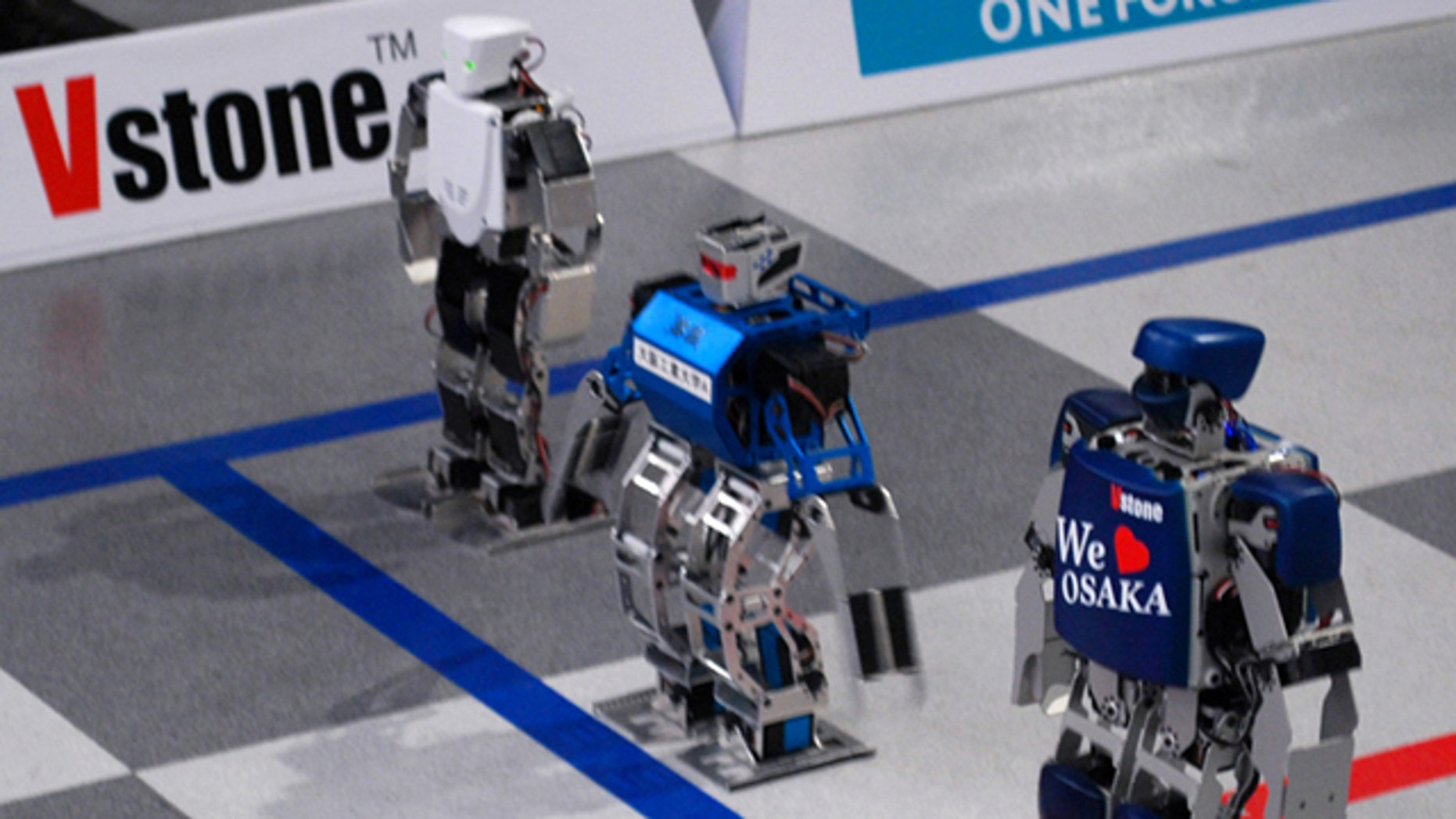 Robots line up for a race during a press conference Wednesday, Feb. 16, 2011, announcing the world's first full marathon for robots will be kicked off on Feb. 24 in Osaka, western Japan.