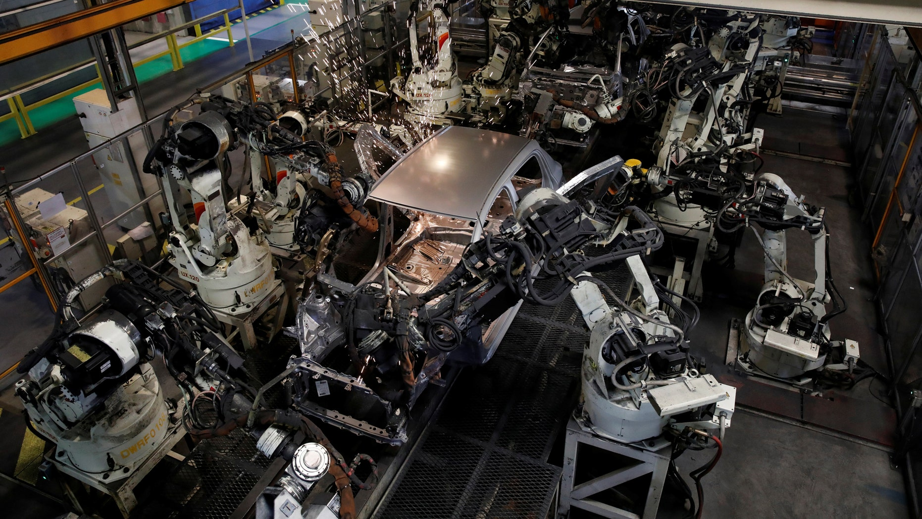 File photo: Robots assemble a Toyota Motor Corp. Yaris at the company's plant in Onnaing, near Valenciennes, France, May 17, 2017. (REUTERS/Benoit Tessier)
