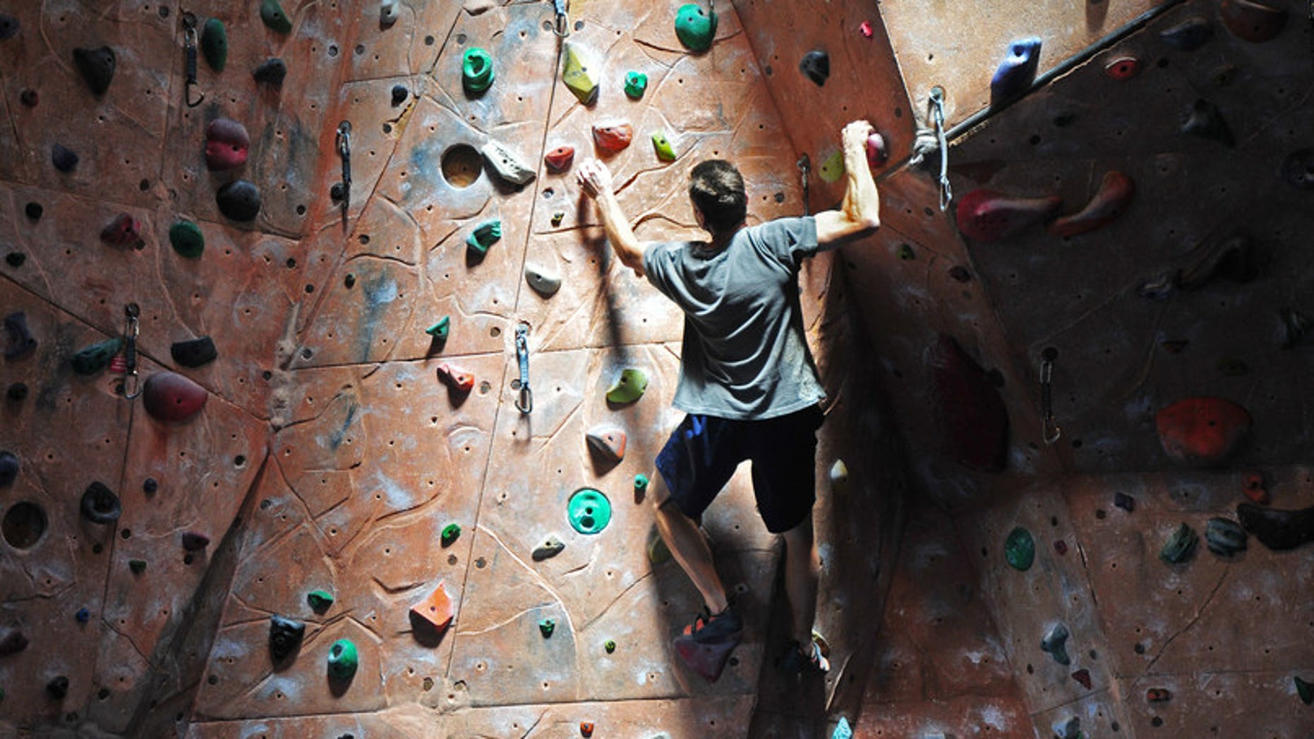 Rock climber on indoor climbing gym