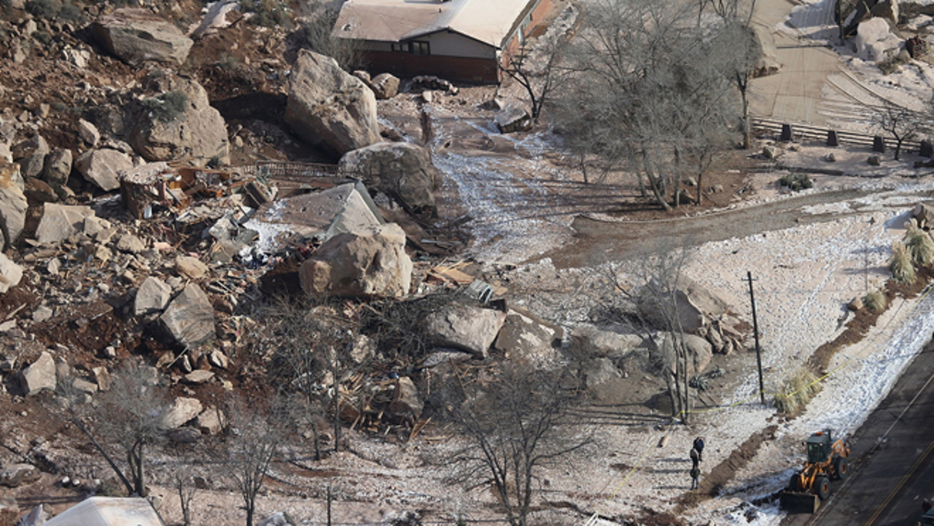 Dec. 13, 2013: In this photo,officials survey the boulders from a rock slide that crushed a home and killed two people, in Rockville, Utah.