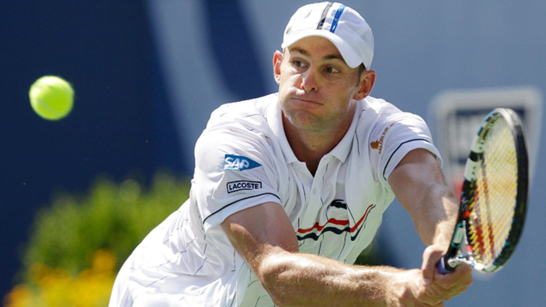 August 28, 2012: Andy Roddick returns a shot to Rhyne Williams at the 2012 US Open tennis tournament in New York.