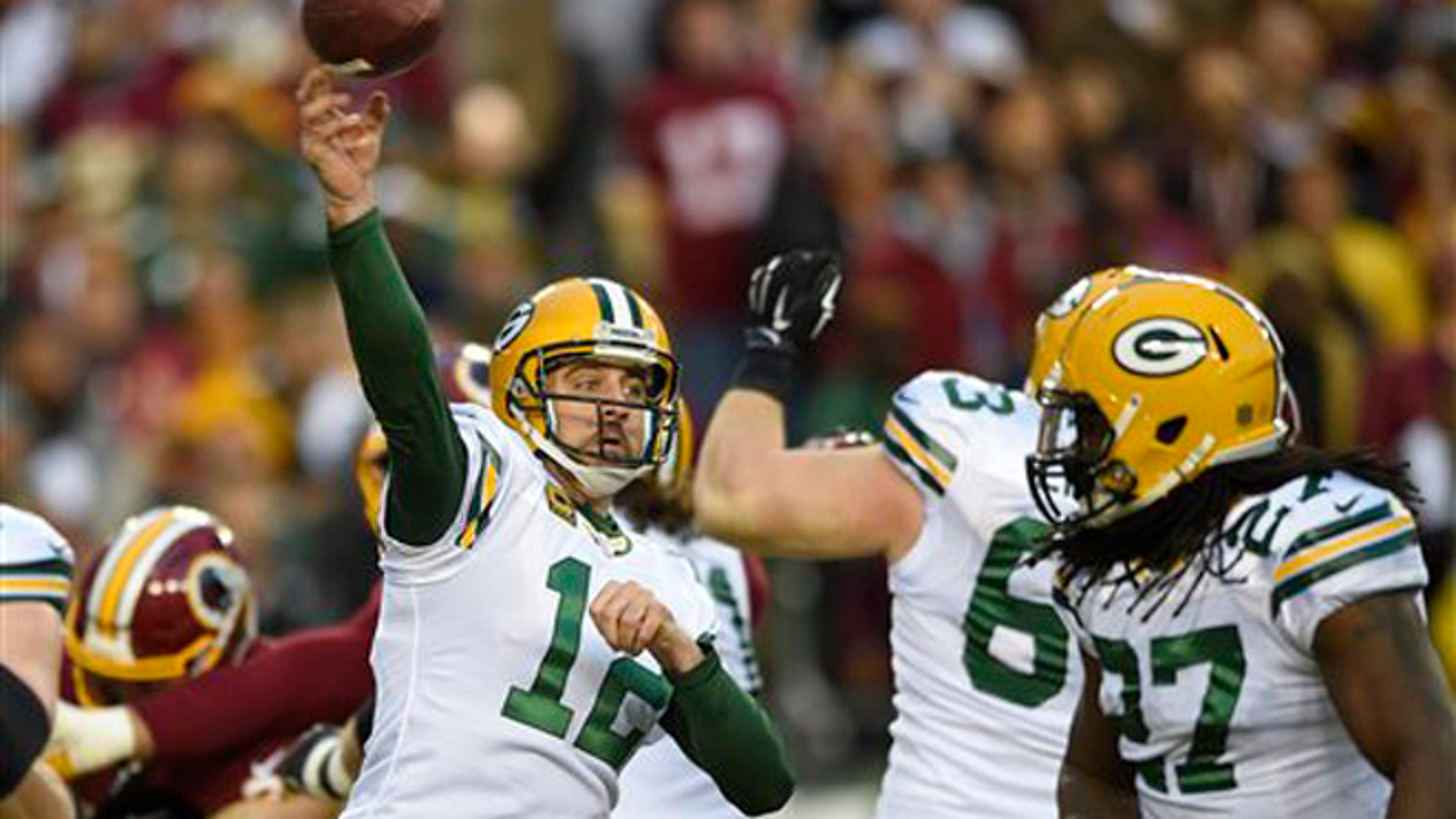 690a7cbd5 Green Bay Packers quarterback Aaron Rodgers (12) throws a pass during the first  half