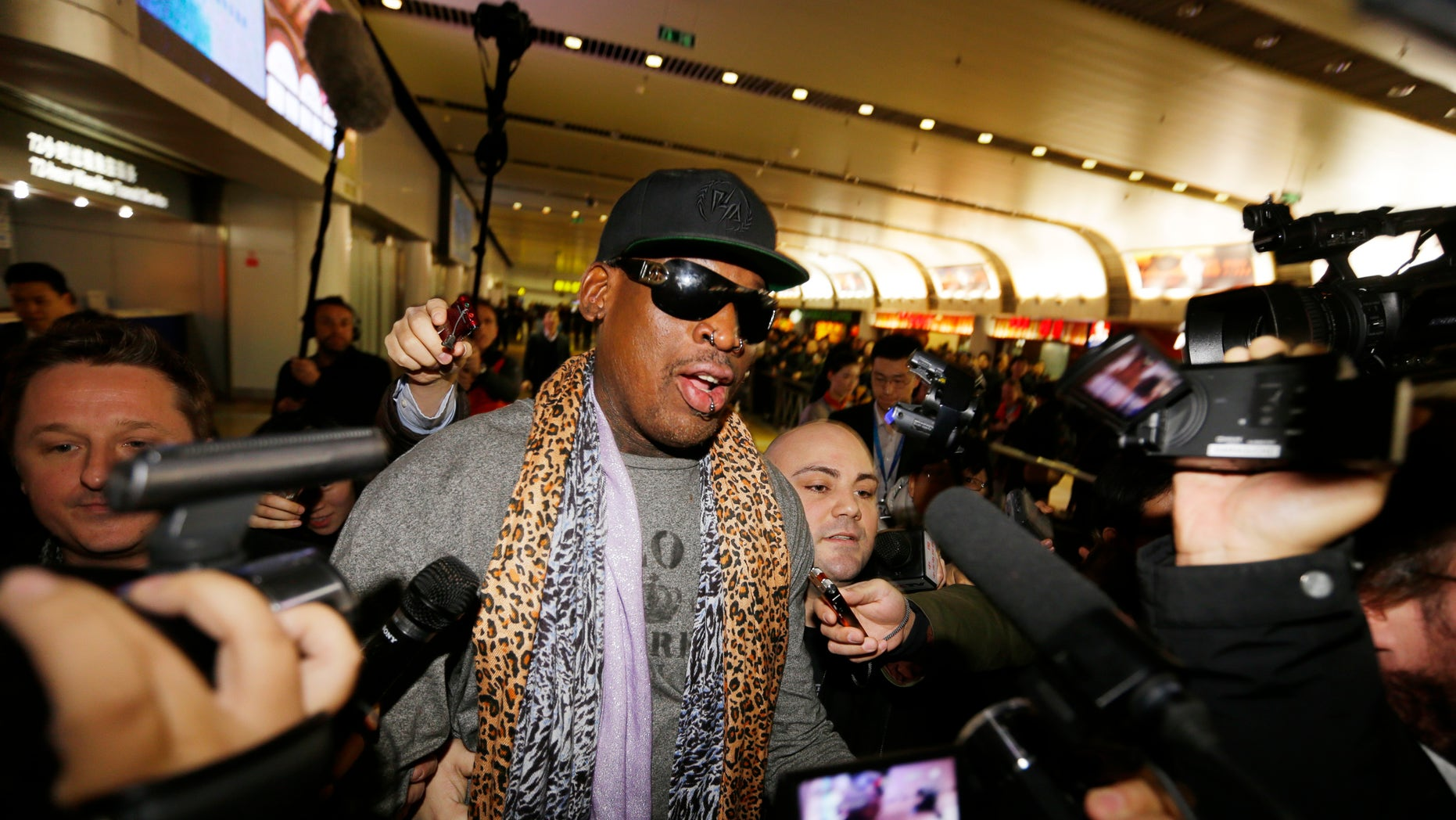 December 23, 2013. Former NBA basketball player Dennis Rodman speaks to the media after returning from his trip to North Korea at Beijing airport.