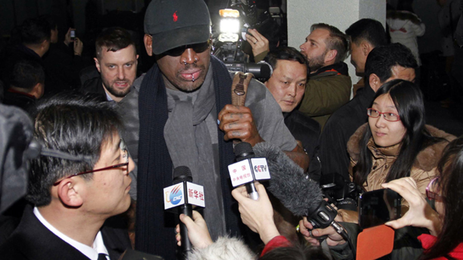 """Feb. 26, 2013: Flamboyant former NBA star Dennis Rodman is surrounded by journalists upon arrival at Pyongyang Airport, North Korea. The American known as """"The Worm"""" arrived in Pyongyang, becoming an unlikely ambassador for sports diplomacy at a time of heightened tensions between the U.S. and North Korea."""