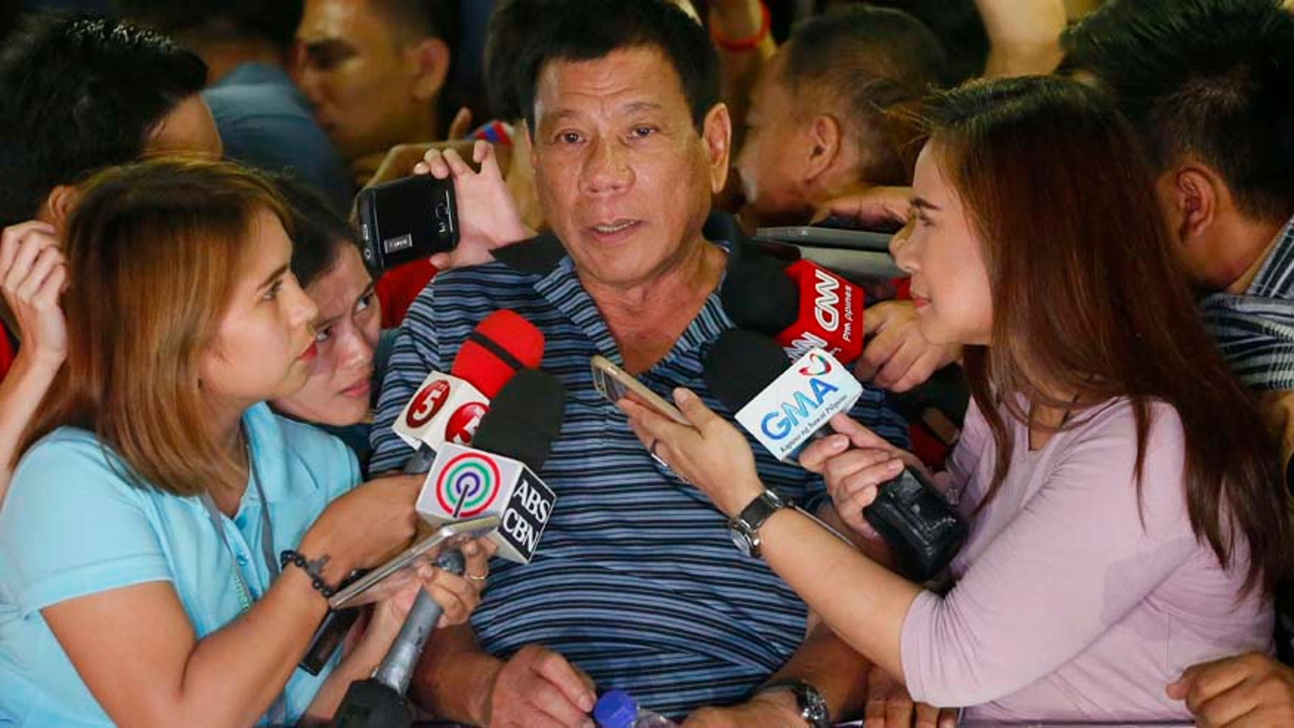 April 22, 2016: Front-running presidential candidate Mayor Rodrigo Duterte talks to the media during a campaign sortie at Silang township, Cavite province south of Manila, Philippines