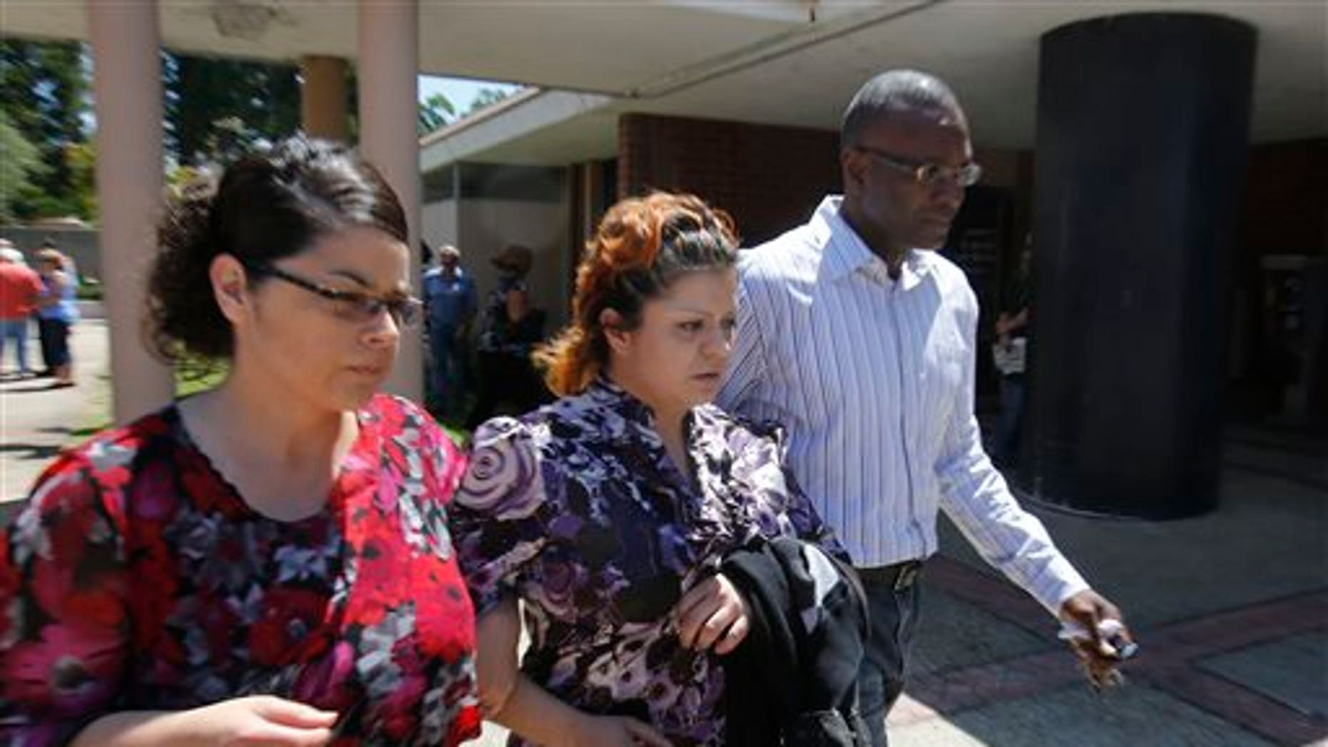 Priscilla Rodriquez, center, the mother of murder victim of Leila Fowler, leaves the Calaveras County Courthouse, in San Andreas, Calif.,  after the arraignment of  her 12-year-old son for Leila's  murder, Wednesday, May 15, 2013.  Leila Fowler, 8, was stabbed to death in her Valley Springs home, last month.  The defendant was charged with second-degree murder and a special allegation for use of a dangerous weapon for the death of Leila Fowler. No plea was entered. (AP Photo/Rich Pedroncelli)