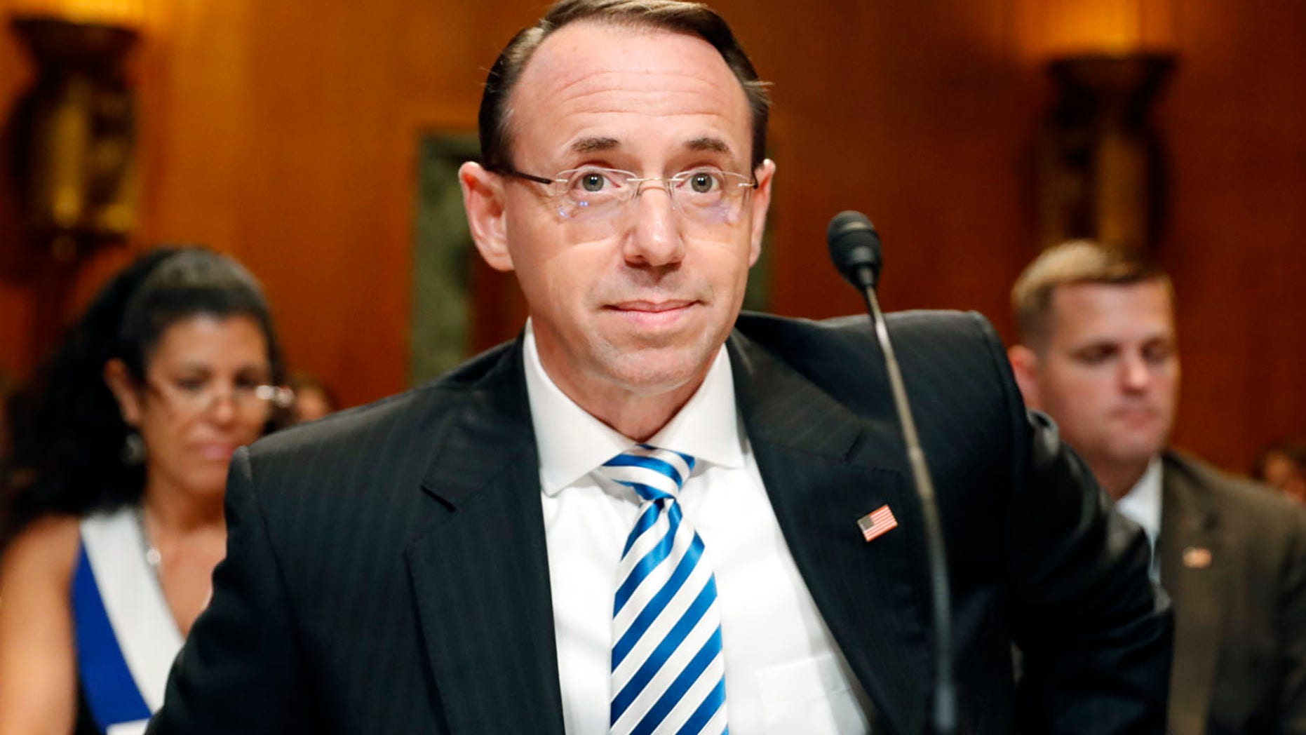 Deputy Attorney General Rod Rosenstein prepares to testify on Capitol Hill in Washington, Tuesday, June 13, 2017, before a Senate Appropriations subcommittee hearing on the Justice Department's fiscal 2018 budget. Rosenstein said he has seen no evidence of good cause to fire the special prosecutor overseeing the Russia investigation. (AP Photo/Alex Brandon)