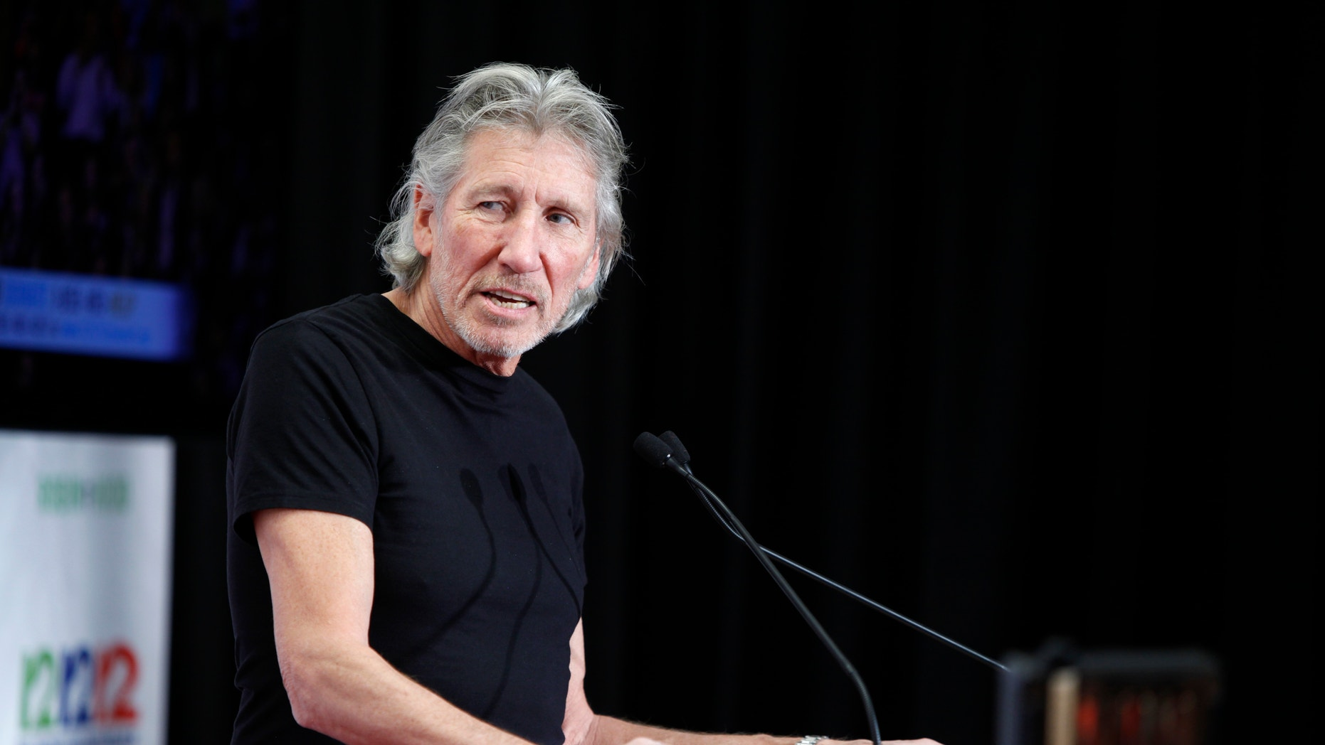 "Musician Roger Waters speaks to the media backstage during the ""12-12-12"" benefit concert for victims of Superstorm Sandy at Madison Square Garden in New York, December 12, 2012."