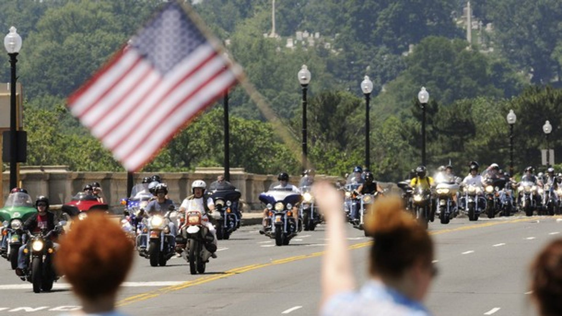 Motorcycle riders take part in the annual Rolling Thunder demonstration, crossing the Memorial Bridge in front of Arlington Cemetery to pay their respects at the Vietnam Veterans Memorial in Washington, May 30, 2010. (Reuters)