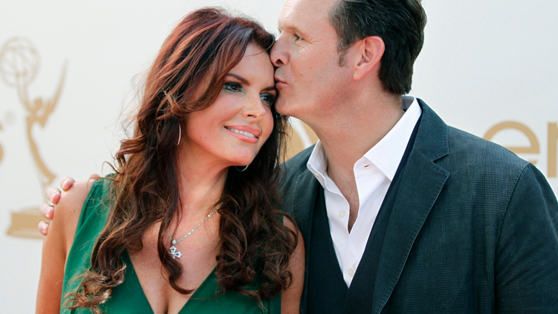 Producer Mark Burnett and his wife, actress and producer Roma Downey, arrive at the 63rd Primetime Emmy Awards in Los Angeles September 18, 2011. REUTERS/Danny Moloshok (UNITED STATES  - Tags: ENTERTAINMENT)   (EMMYS-ARRIVALS) - RTR2RISO