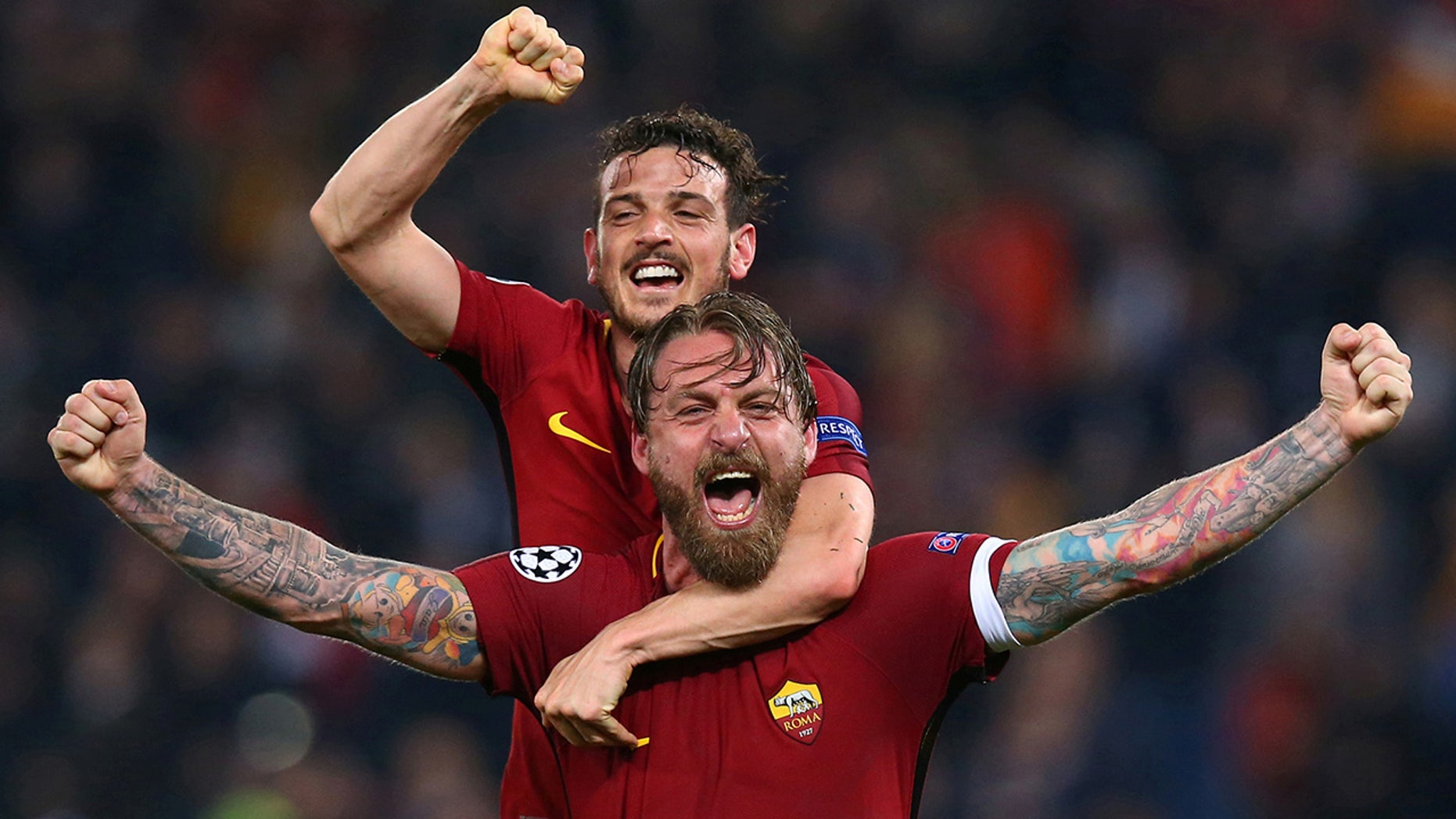 Roma's Daniele De Rossi and Alessandro Florenzi celebrate after the match against Barcelona at the Stadio Olimpico in Rome, Italy.