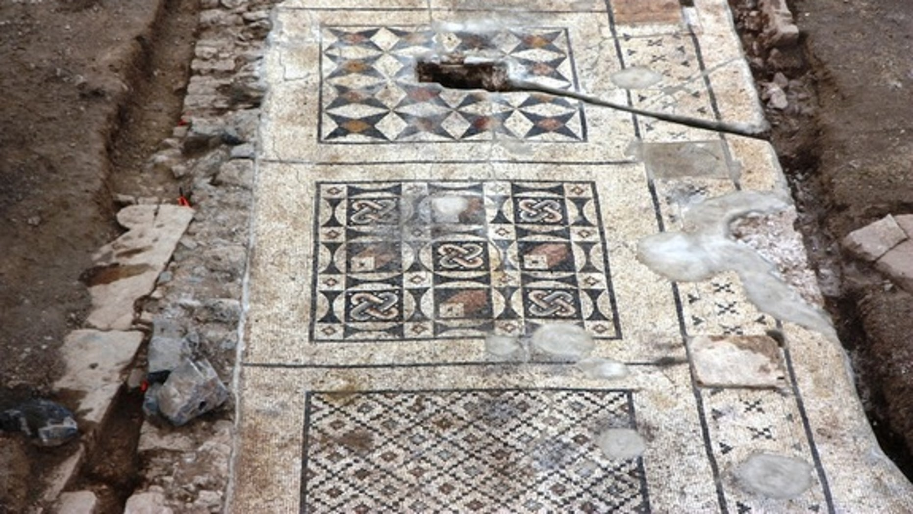 Each section of the mosaic features its own geometric design.