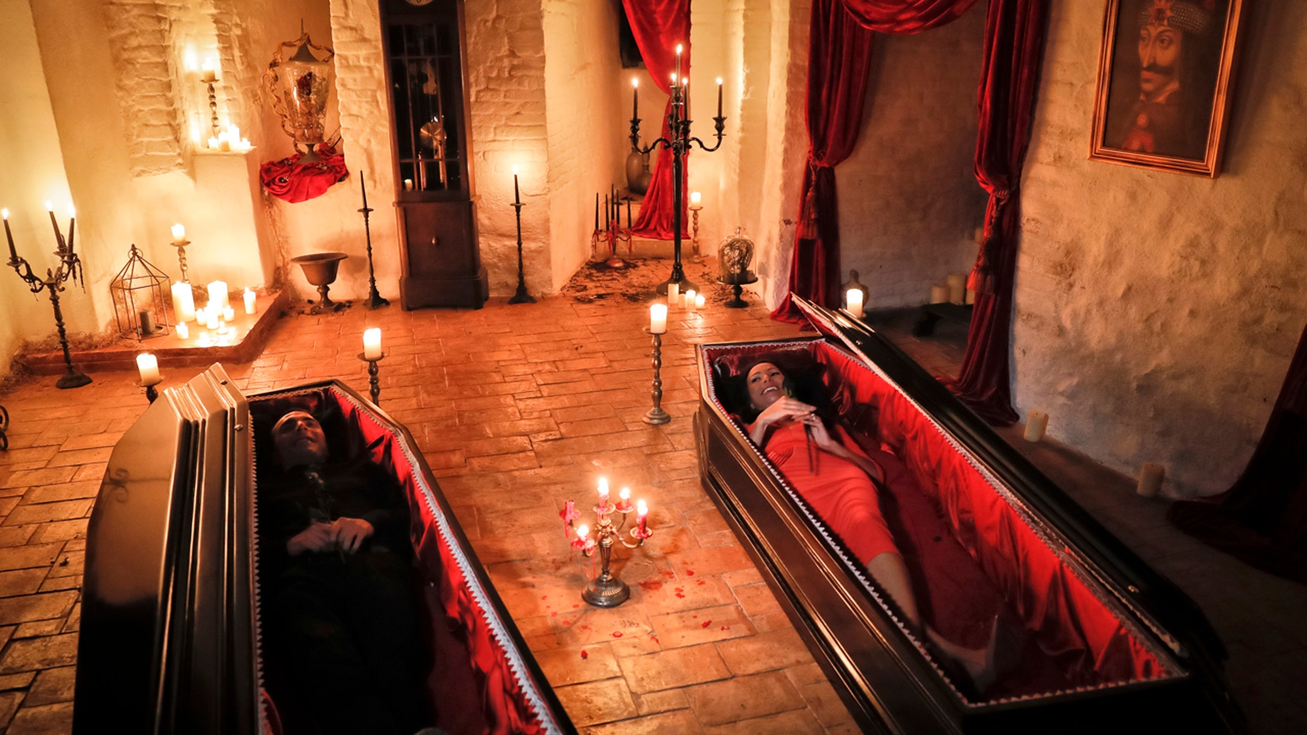 Tami Varma, right, and her brother Robin, the grandchildren of Devendra Varma, a scholar of English gothic tales and an expert in vampire lore, pose in coffins, at the Bran Castle, in Bran, Romania, Monday, Oct. 31, 2016.