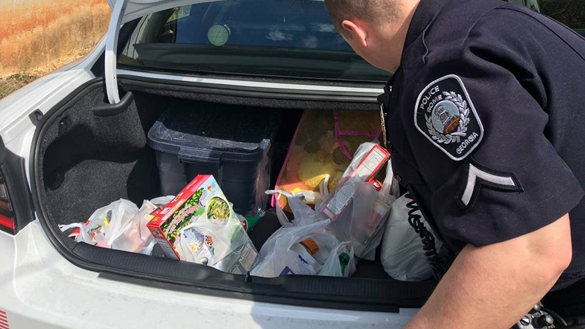 Two Rome, GA police officers bought over $50 worth of groceries for a teen caught shoplifting.