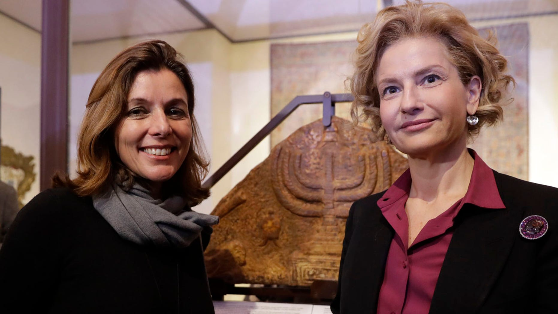 Feb. 20, 2017: Director of the Vatican Museums, Barbara Jatta, left, and Director of Rome's Jewish Museum Alessandra Di Castro pose for a photo in front of a bas-relief showing a menorah at the end of a press conference in Rome.