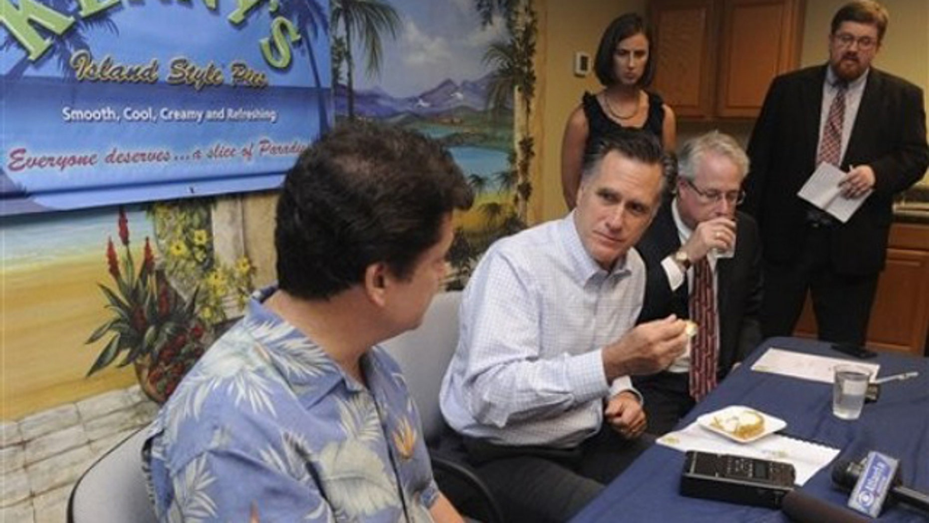 Thursday: Republican presidential hopeful, former Mass. Gov. Mitt Romney, takes a bite of pie while talking to Kenny Burts, left, owner of the small Georgia business Kenny's Great Pies in Smyrna.
