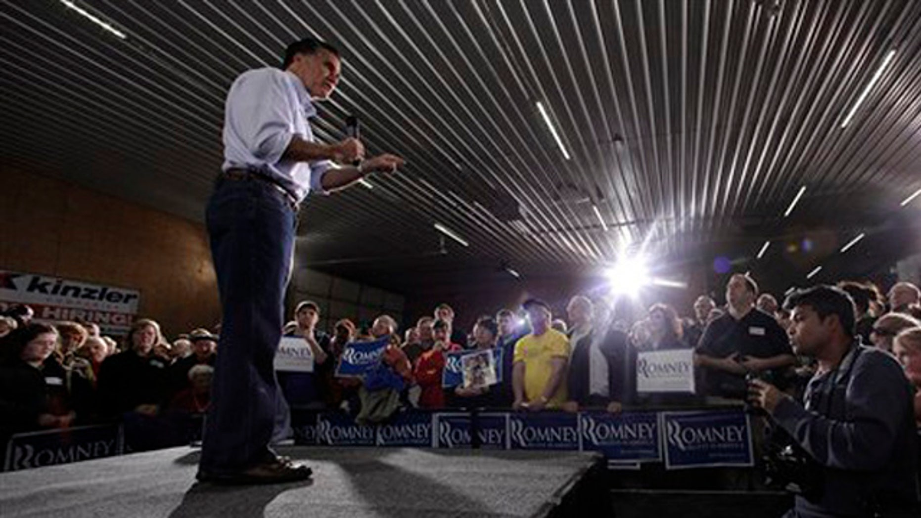 Dec. 29, 2011: Mitt Romney  speaks during a campaign stop at Kinzler Construction in Ames, Iowa.