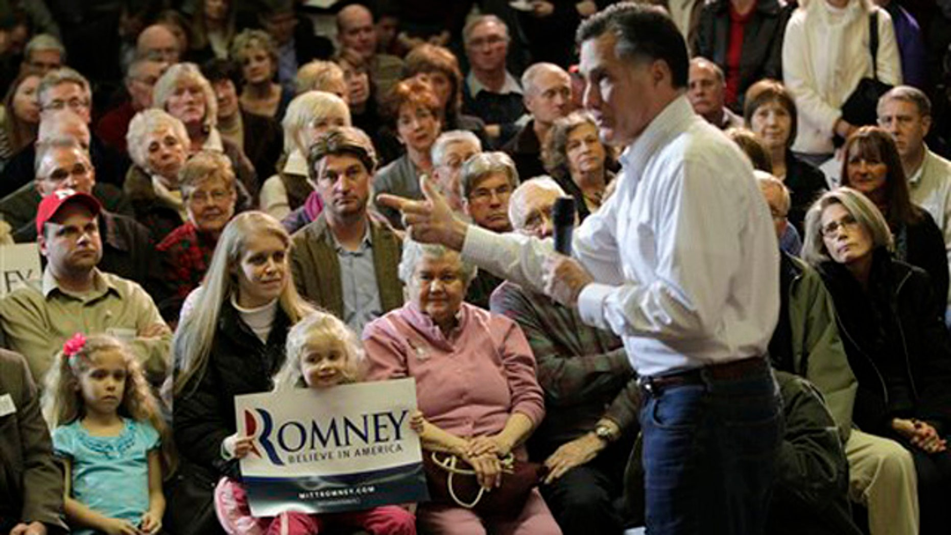 Jan. 1, 2012: Mitt Romney speaks to a packed room during a campaign appearance at the Bayliss Park Hall in Council Bluffs, Iowa.