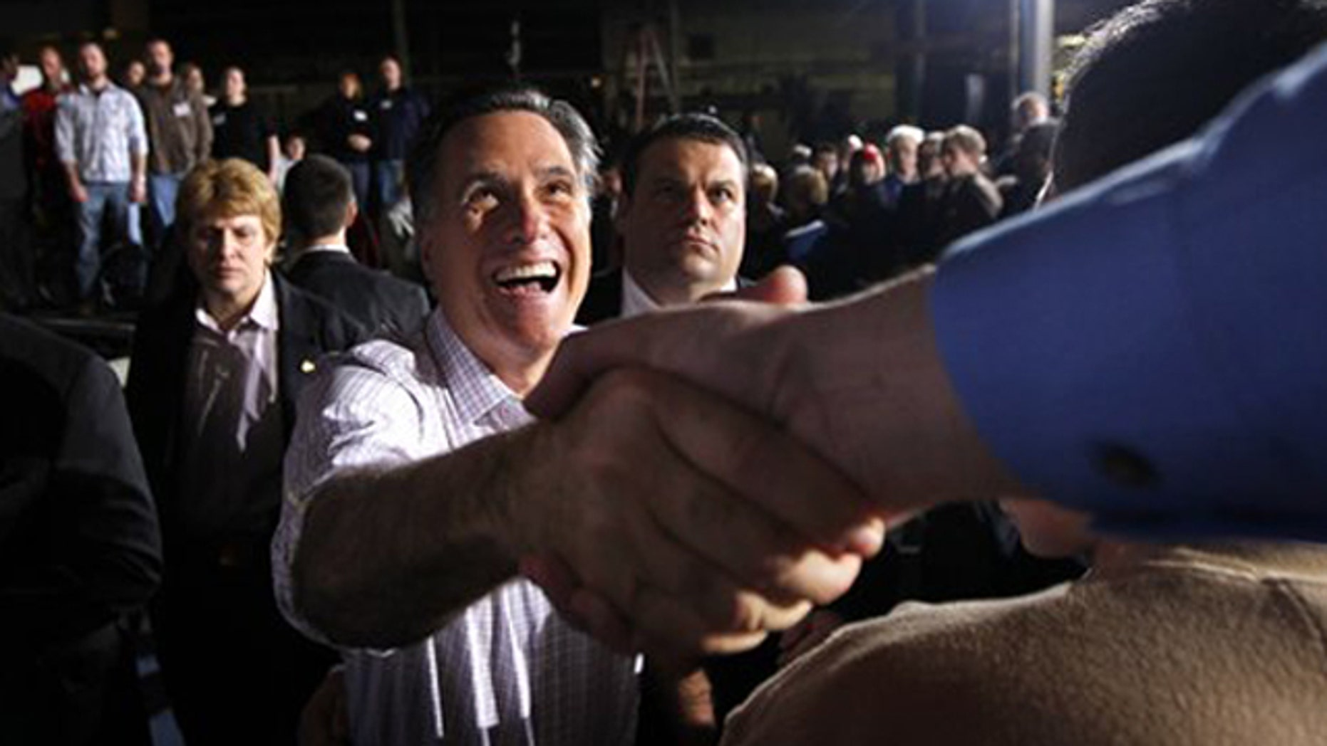 March 3, 2012: Mitt Romney greets supporters at a town hall meeting in Dayton, Ohio.