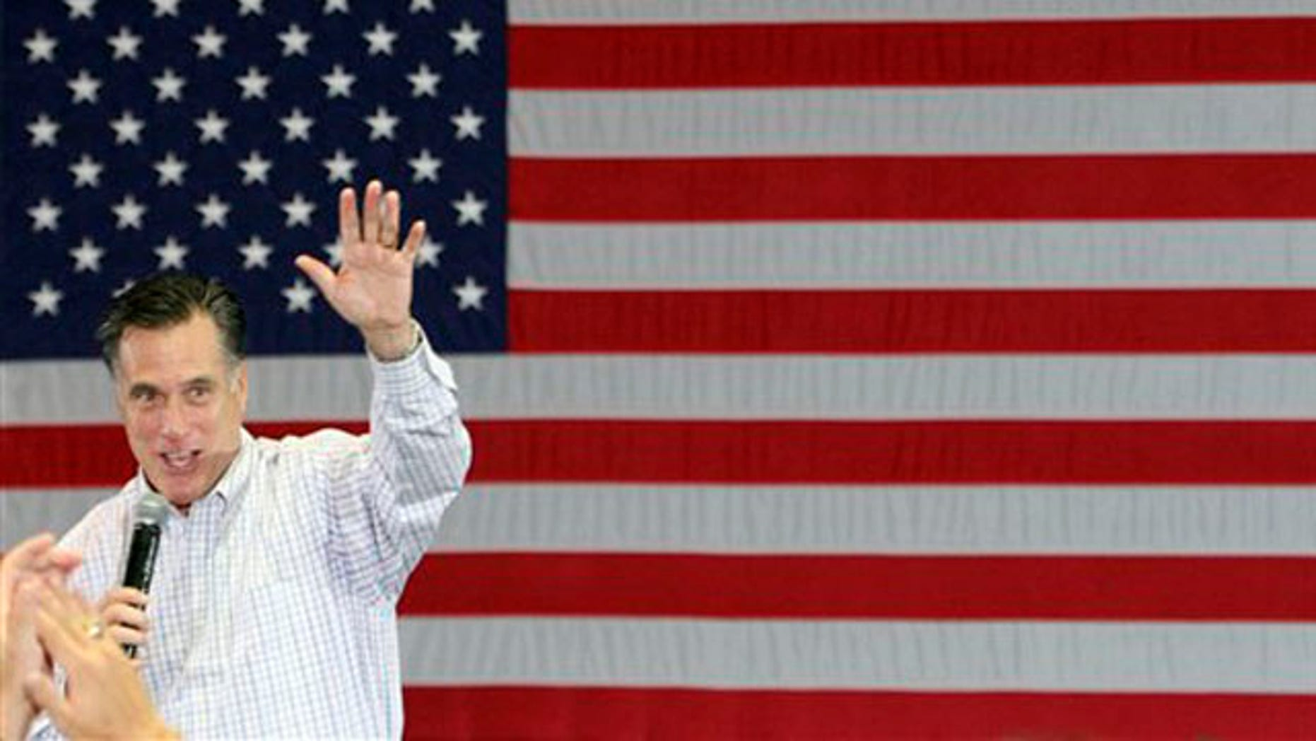 Jan. 12, 2012: Mitt Romney waves after a campaign stop at the Palm Beach Convention Center in West Palm Beach, Fla.