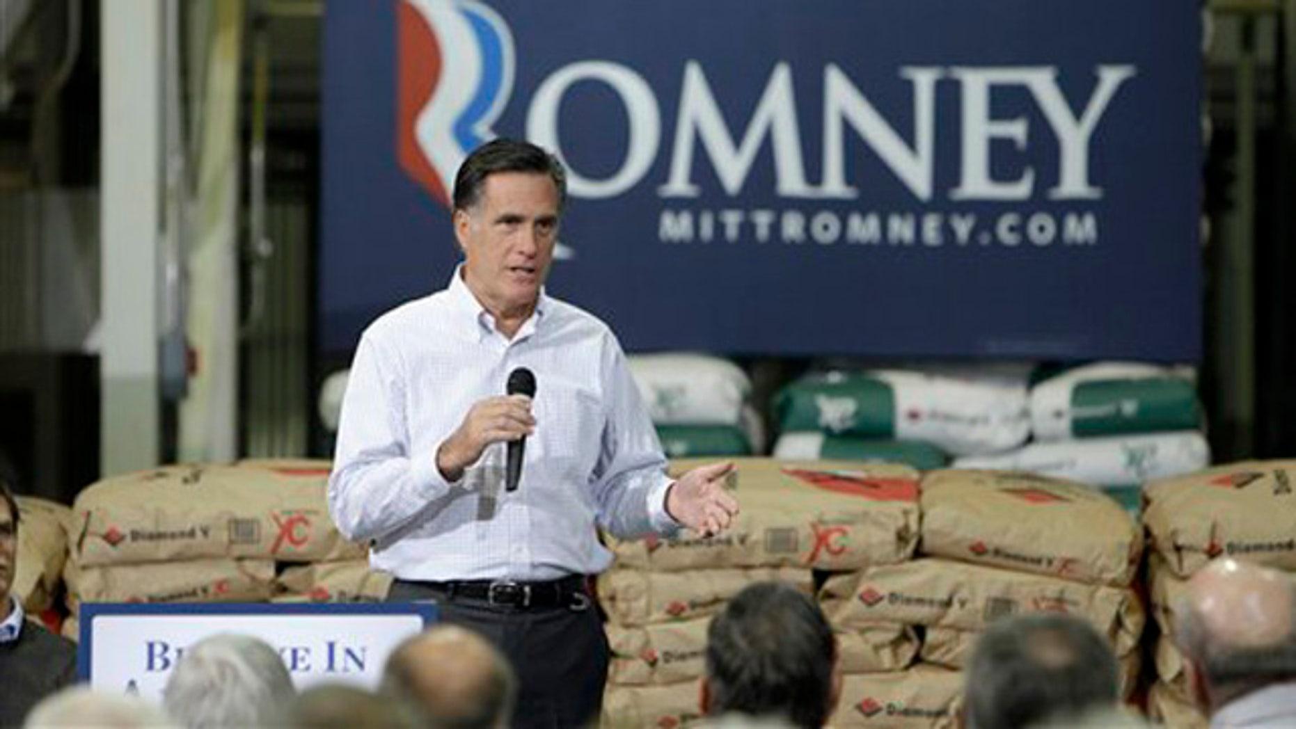 Dec. 9, 2011: Former Massachusetts Gov. Mitt Romney speaks during a town hall meeting in Cedar Rapids, Iowa.