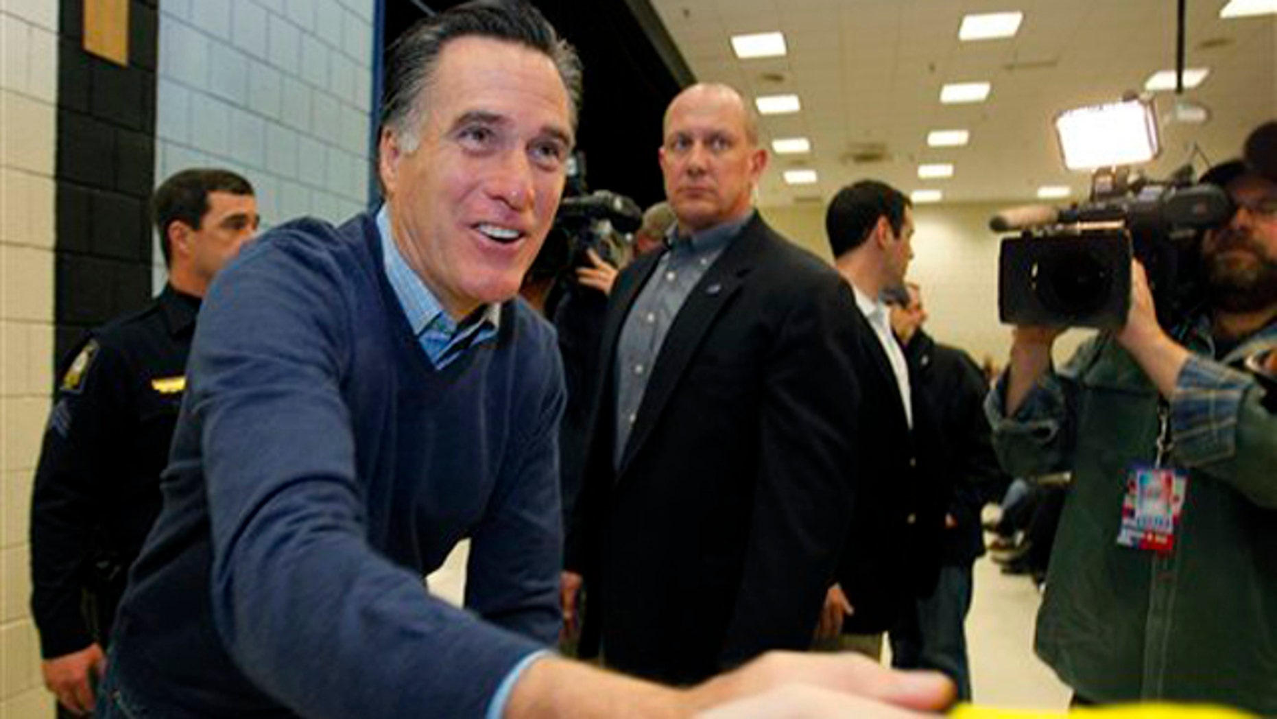 Feb. 11, 2012: Mitt Romney greets supporters at a caucus in Portland, Maine.