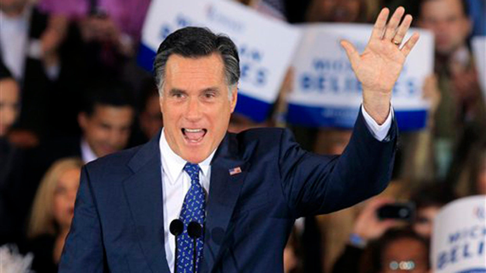 Feb. 28, 2012: Mitt Romney waves at his election night party in Novi, Mich.