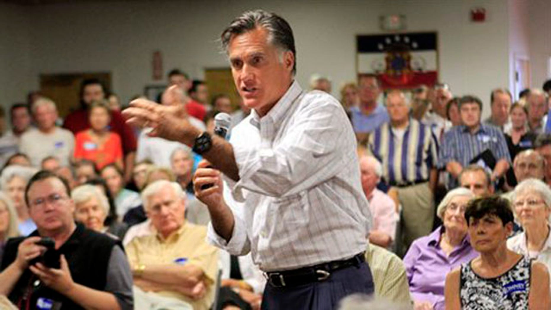 Former Massachusetts Gov. Mitt Romney speaks to a packed crowd during a Town Hall meeting Aug. 8 in Nashua, N.H.
