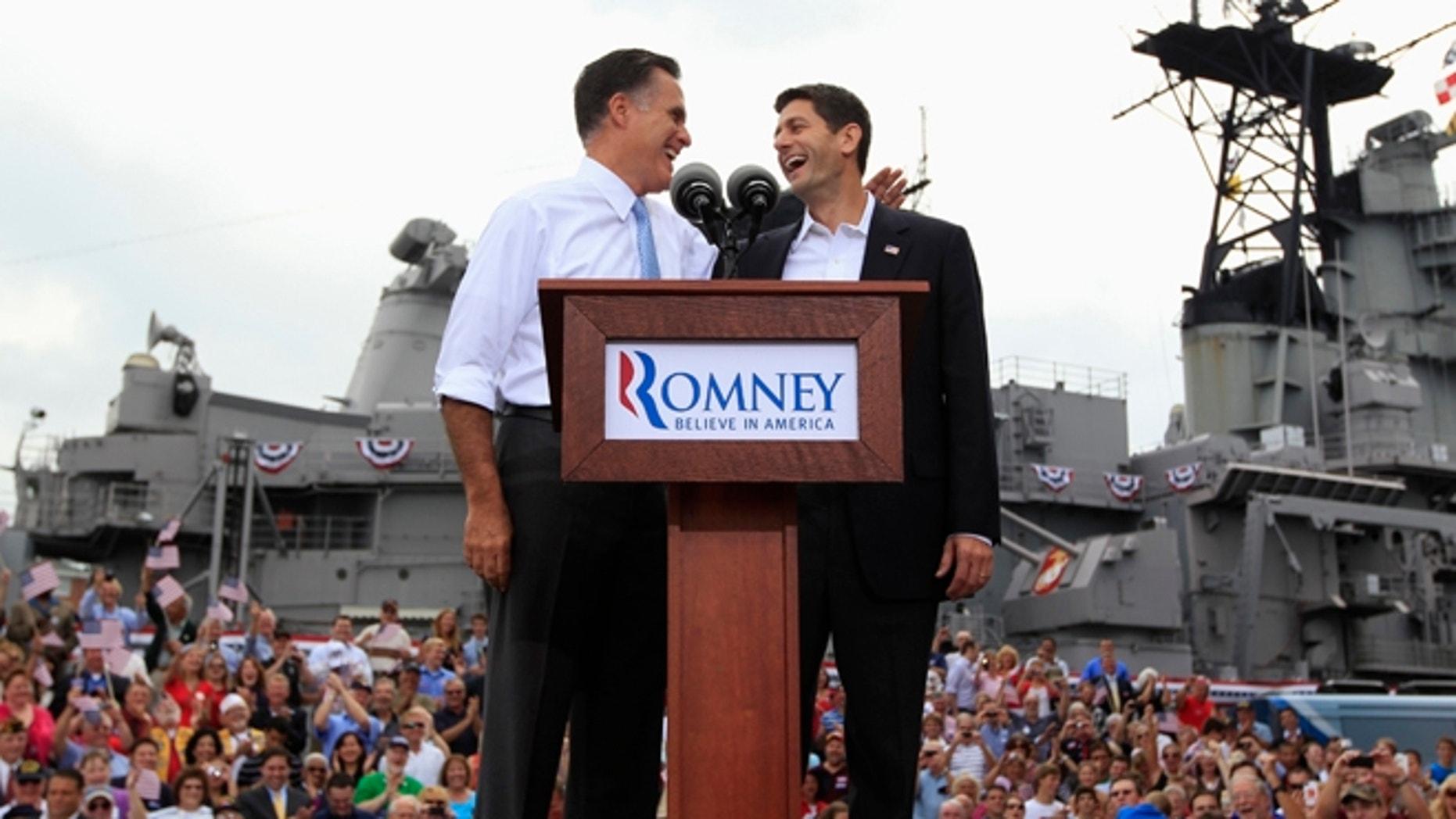 Aug. 11, 2012: Mitt Romney joins Rep. Paul Ryan as he announces the Wisconsin congressman as his running mate in Norfolk, Va.