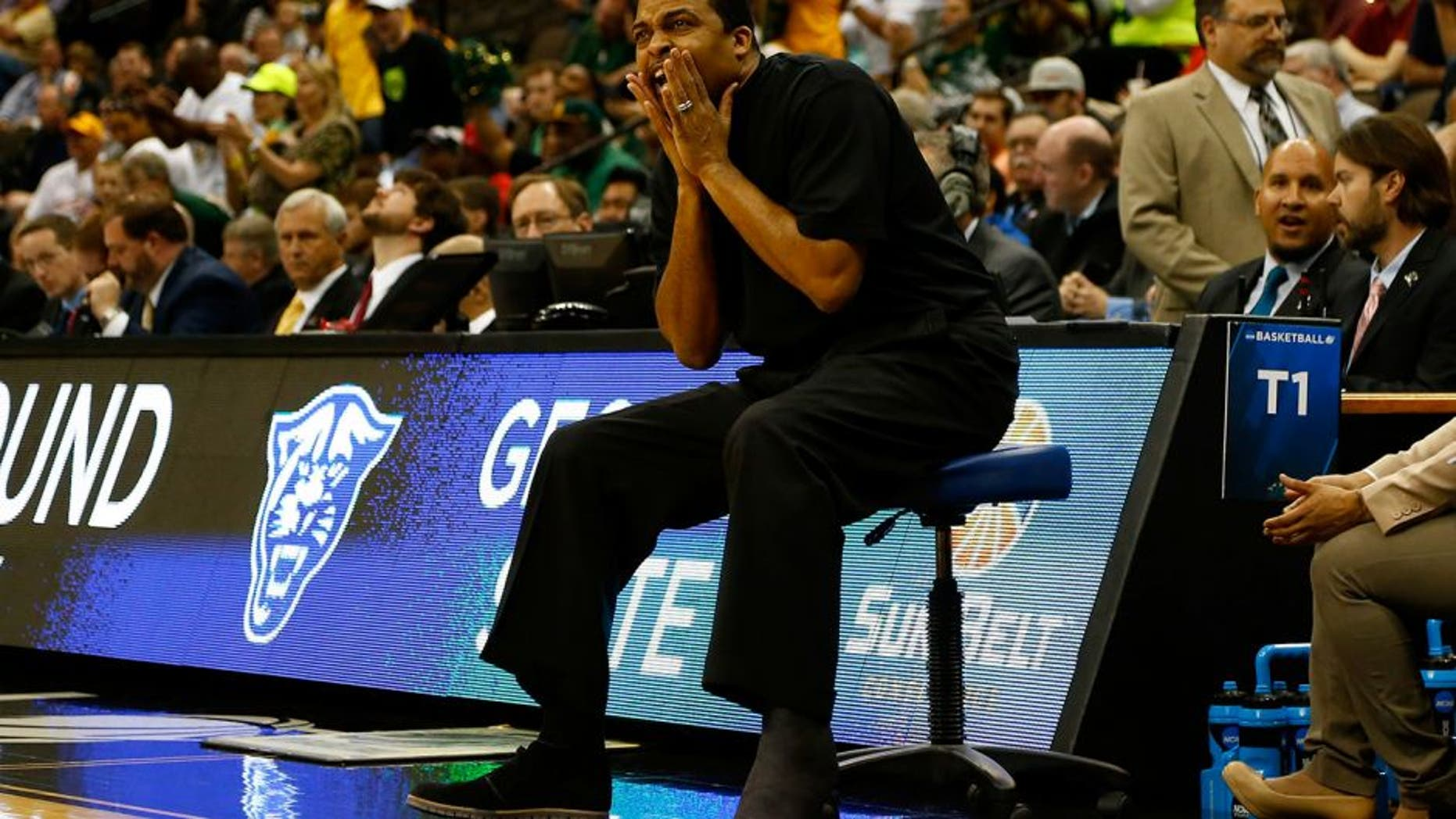 JACKSONVILLE, FL - MARCH 19: Head coach Ron Hunter of the Georgia State Panthers coaches from a chair during the second round of the 2015 NCAA Men's Basketball Tournament at Jacksonville Veterans Memorial Arena on March 19, 2015 in Jacksonville, Florida. Hunter injured his Achilles last week during the Sun Belt Conference tournament championship game. (Photo by Kevin C. Cox/Getty Images)