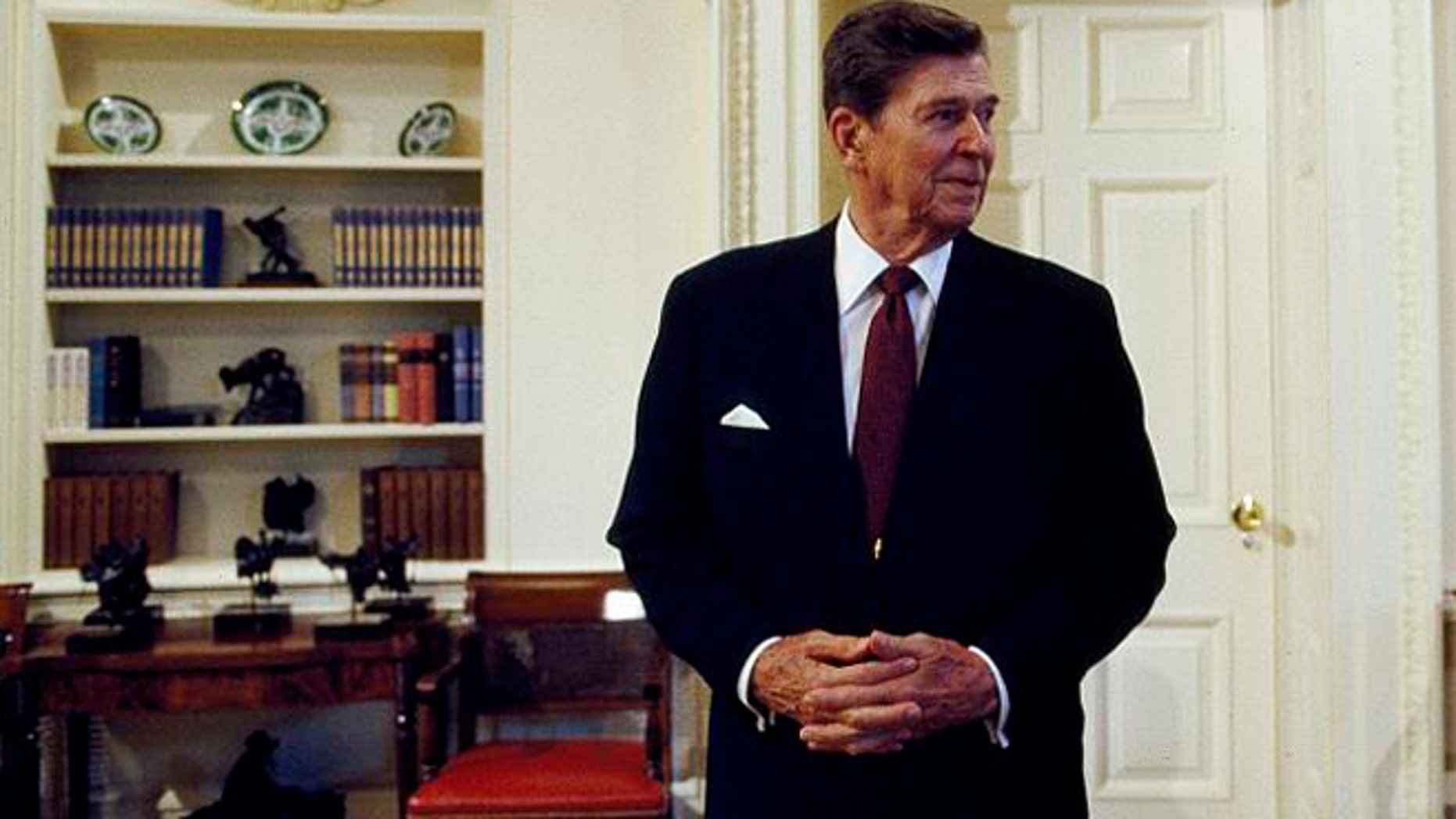 President Ronald Reagan in the Oval Office of the White House during his last term.