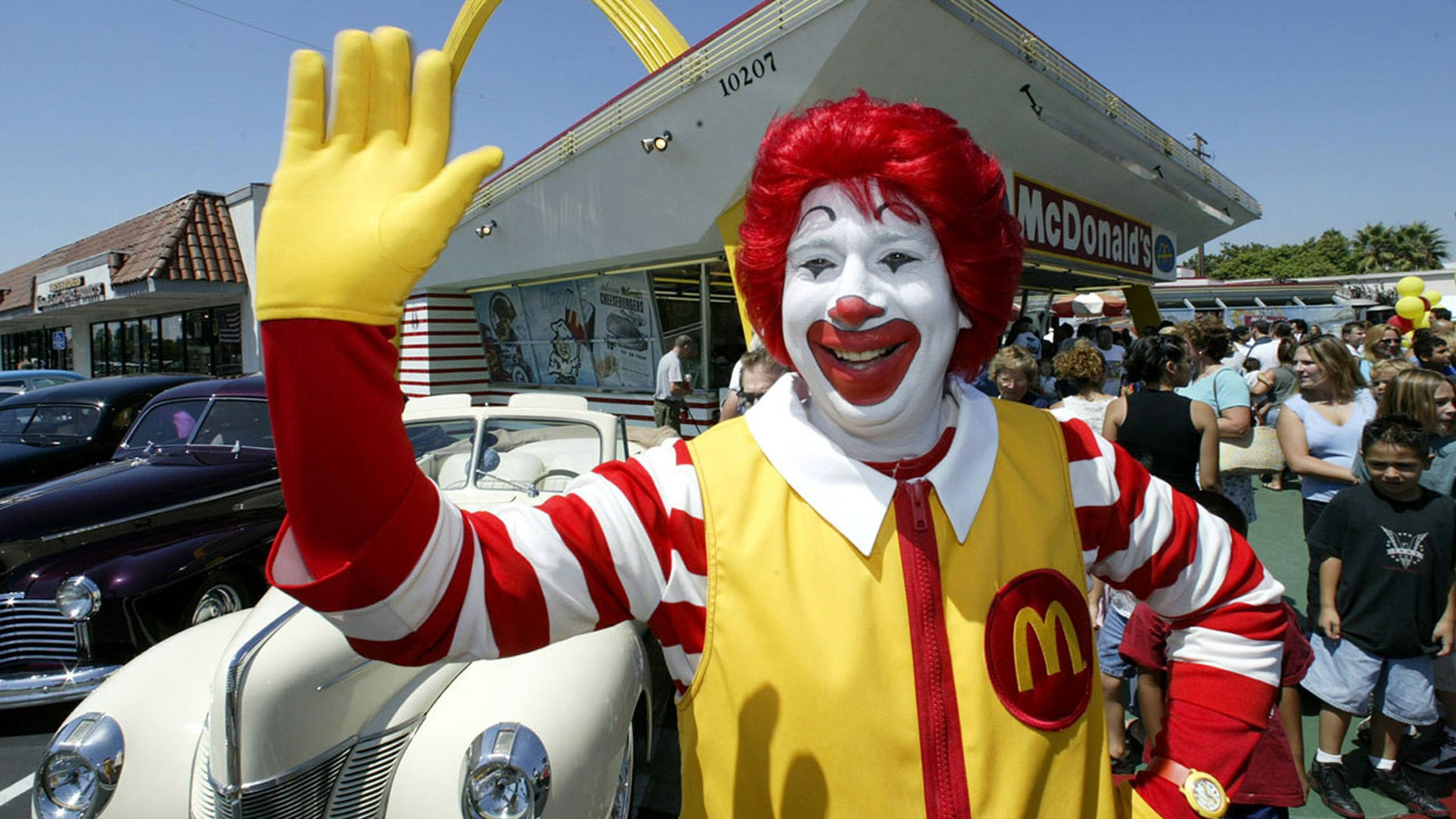 """Several men dressed as Ronald McDonald mobbed the Burger King """"for a laugh,"""" says a witness."""