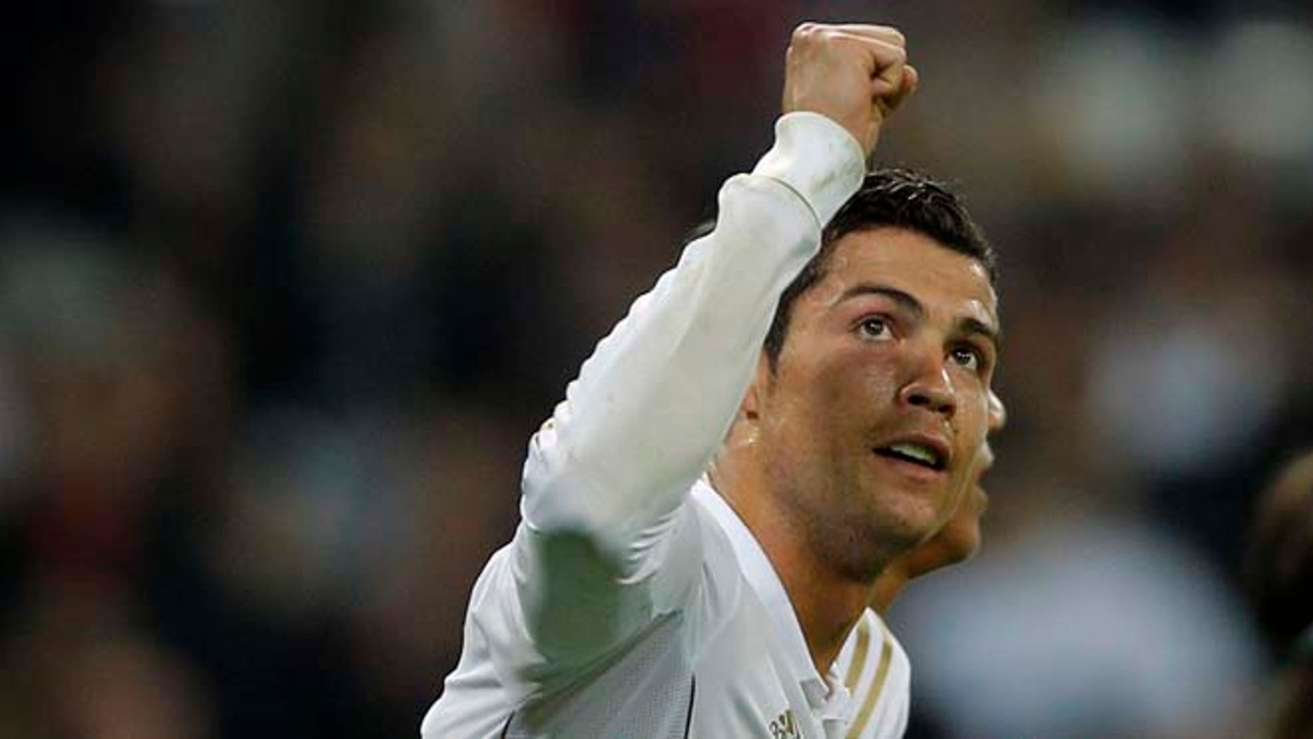 Real Madrid's Cristiano Ronaldo from Portugal celebrates his goal against APOEL Nicosia with during a second leg Champions League quarterfinal soccer match at the Santiago Bernabeu stadium, in Madrid, Wednesday, April 4, 2012.