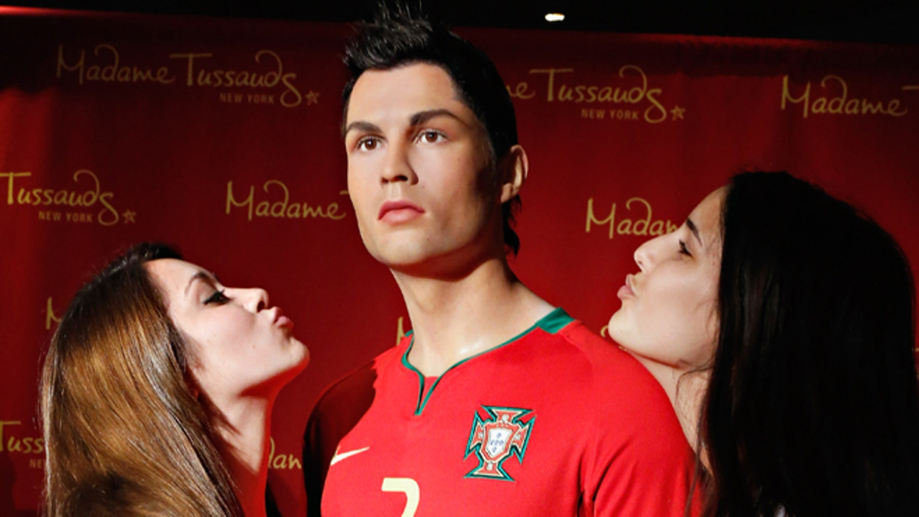 Fans get close to the Cristiano Ronaldo wax figure at Madame Tussauds in New York City.  (Photo by Cindy Ord/Getty Images for Madame Tussauds New York)