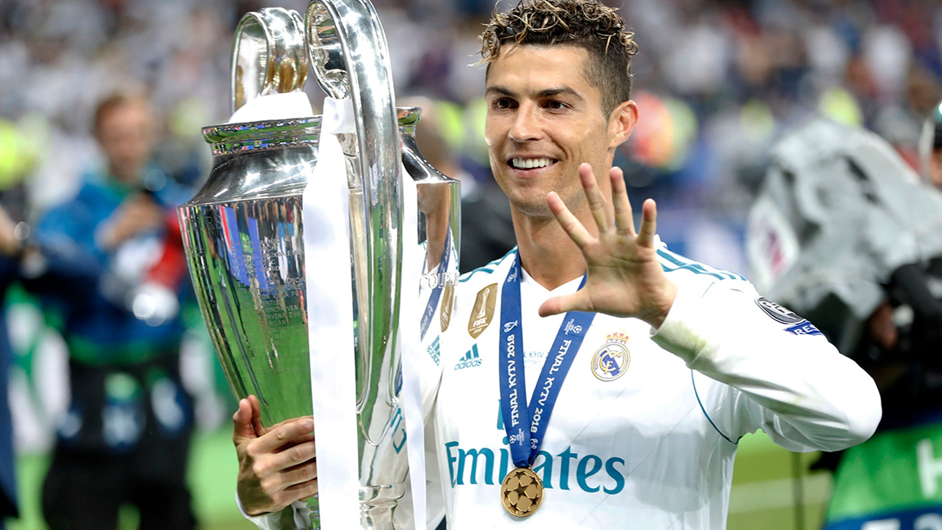 Real Madrid's Cristiano Ronaldo celebrates with the trophy after winning the Champions League Final soccer match between Real Madrid and Liverpool at the Olimpiyskiy Stadium in Kiev, Ukraine, May 26, 2018