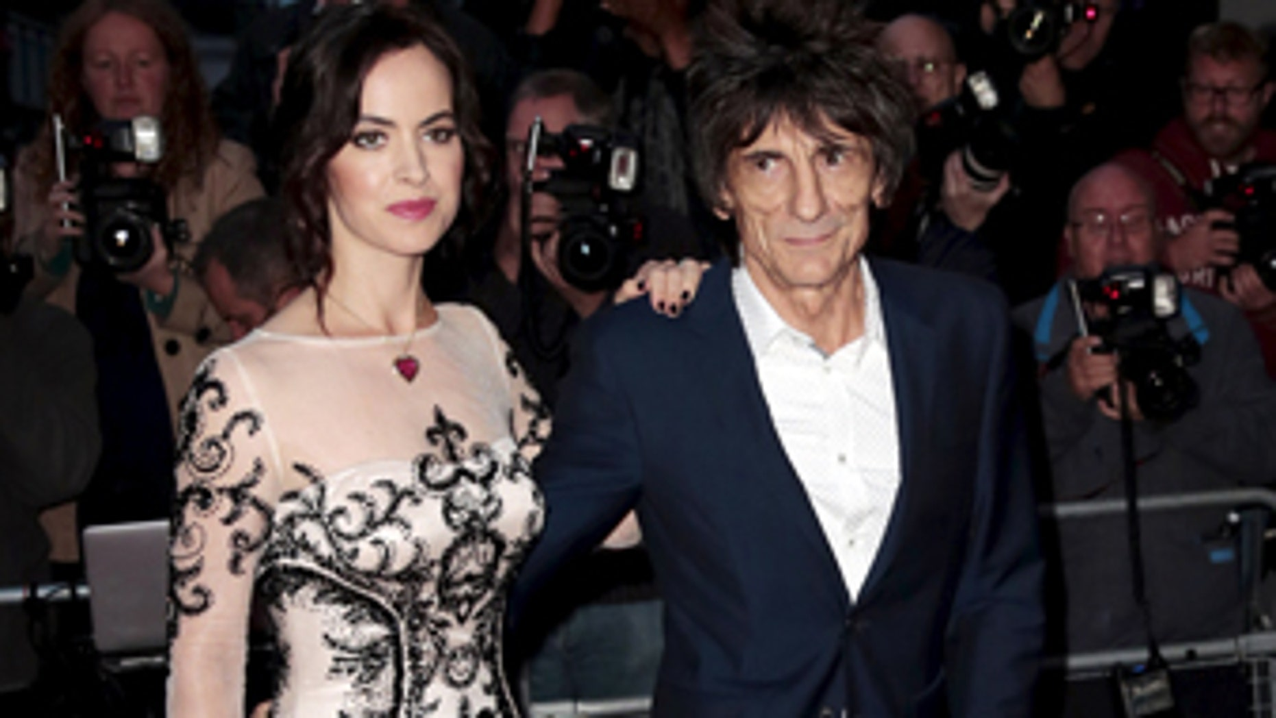 Ronnie Wood of the Rolling Stones and his wife Sally Wood arrive for the GQ Men of the Year Awards at the Royal Opera House in London, Britain September 8, 2015.