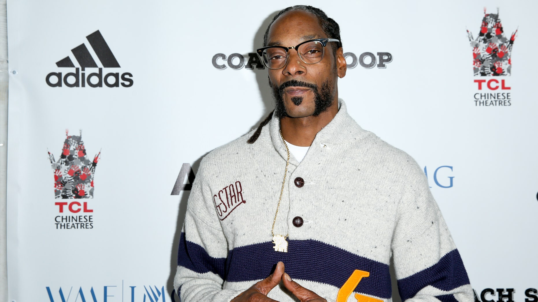 "FILE - In this, May 16, 2016, file photo, Snoop Dogg arrives at the LA Premiere of ""Coach Snoop"" at the TCL Chinese 6 Theatres in Los Angeles. Snoop Dogg called for a boycott of the History Channel's ""Roots"" remake in an Instagram post on May 30, 2016. (Photo by Rich Fury/Invision/AP, File)"